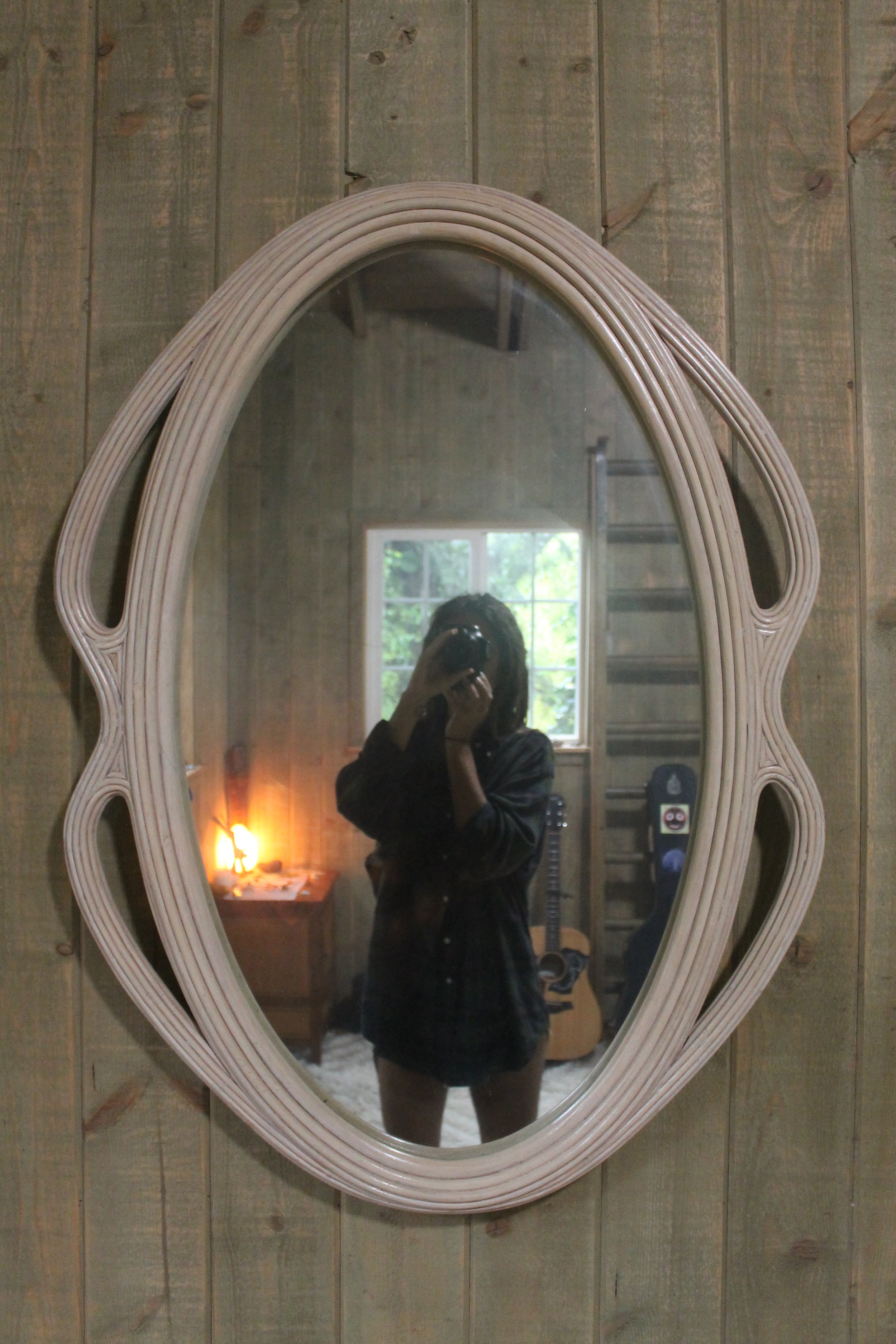 - $20 epic mirror made in the Philippines- from the thrift store.It matches the wood throughout the bungalow.