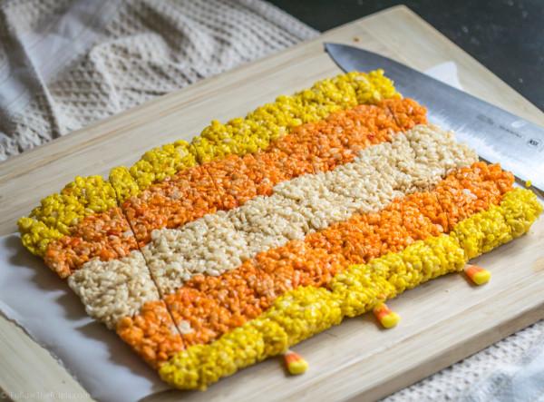Cut rice krispie treats into triangles to shape like candy corn