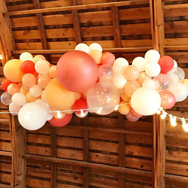 I got to do the sweetest Georgia Peach themed wedding in June and this was one of the peachy balloon installations put up!  As a southerner, I know just how unforgettable Georgia peaches truly are and have the best memory of driving down the road and stopping to buy baskets of peaches from a farmer selling on the side of the road.  Not to mention, this bride was the sweetest!