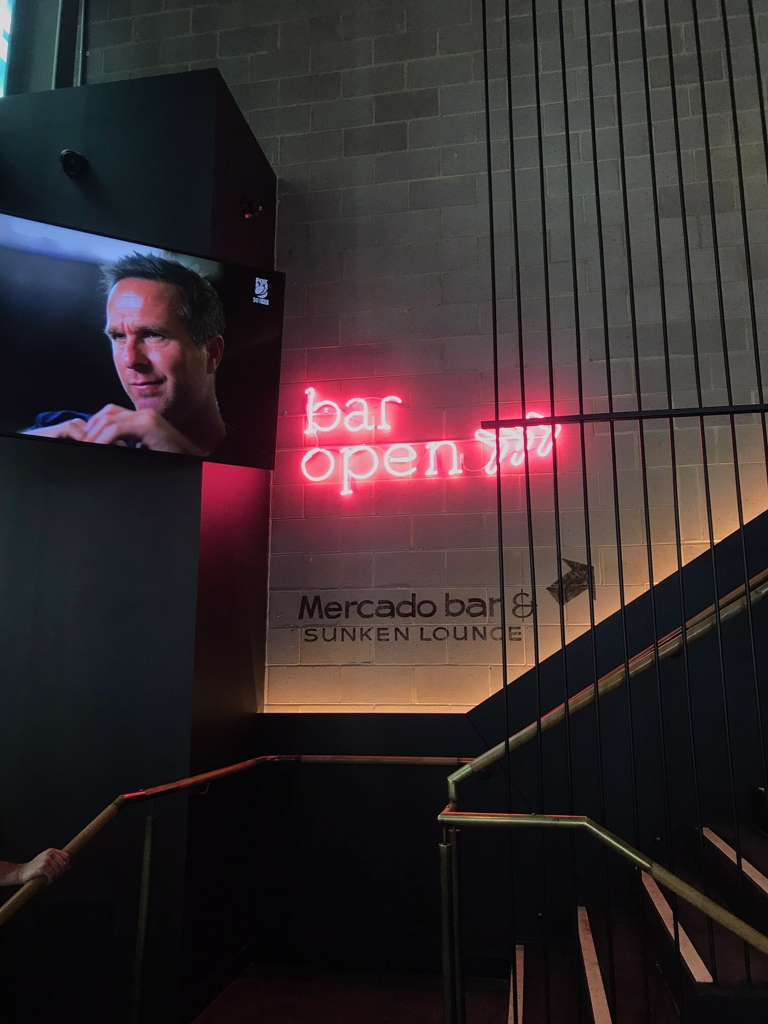 Glass blown hot pink neon letters and arrows for Mercado bar at Market Grounds, Perth City.