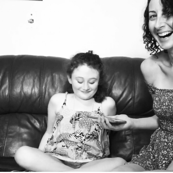 An artist specifically recorded a Christmas song for Mackenzie. This is a photo of us smiling, listening to the song that was loaded on Instagram on Christmas Eve