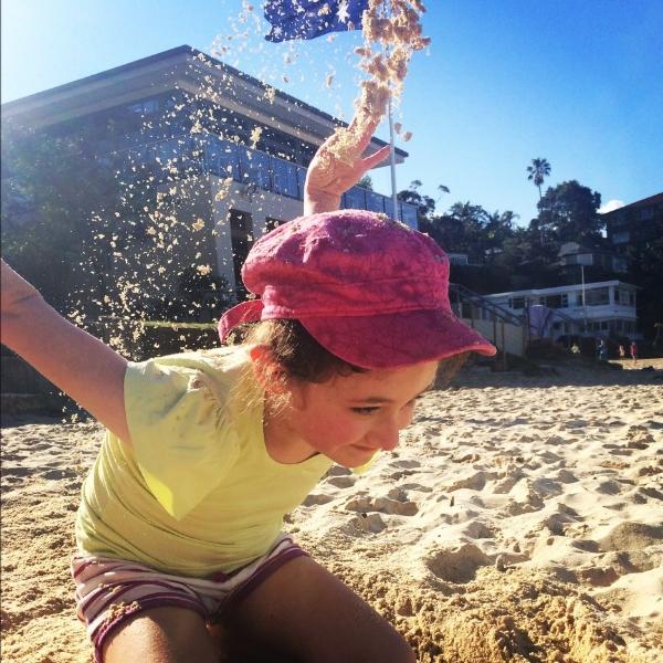 Mackenzie playing with the sand.jpg