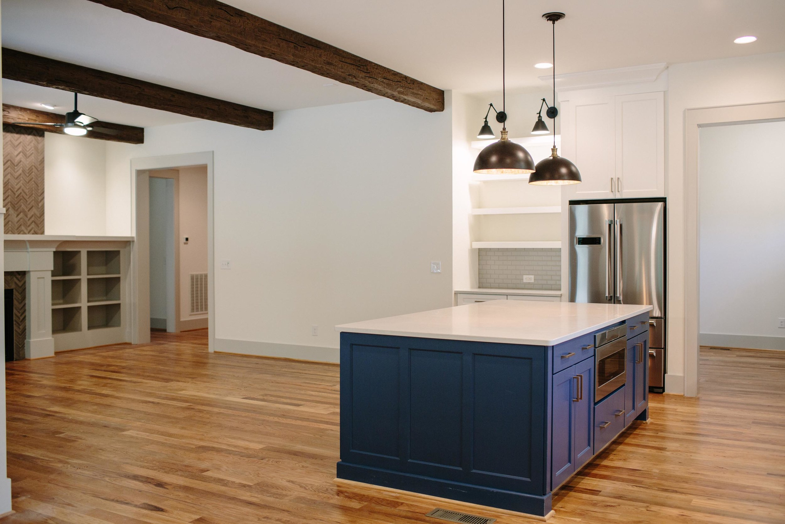 Modern kitchen with blue cabinet and refrigerator