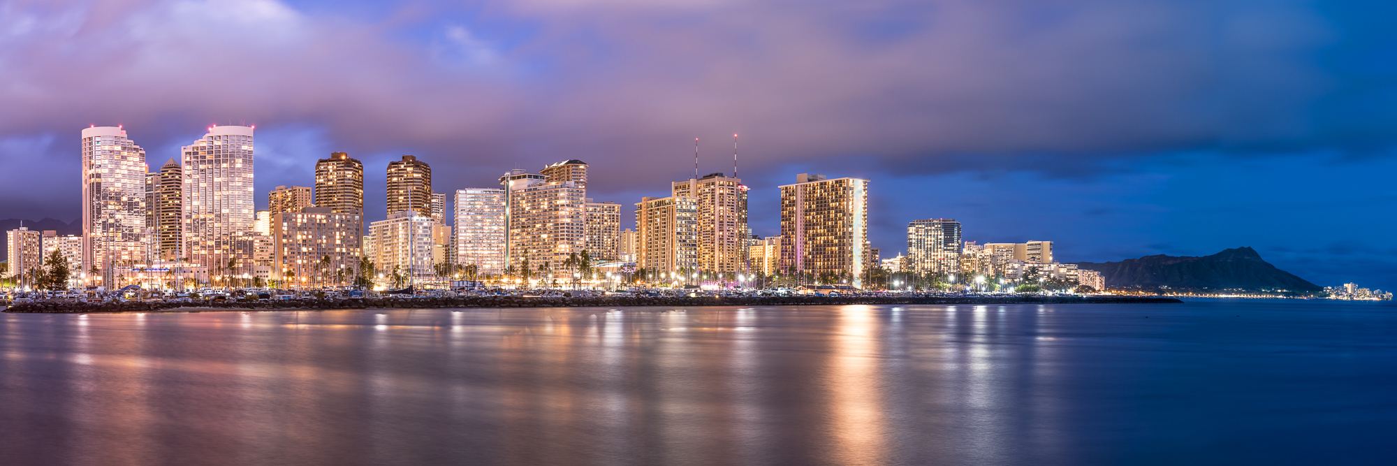 Waikiki city lights and Diamond Head (far right) at night. This shot was a panoramic stitch of 7 photographs.