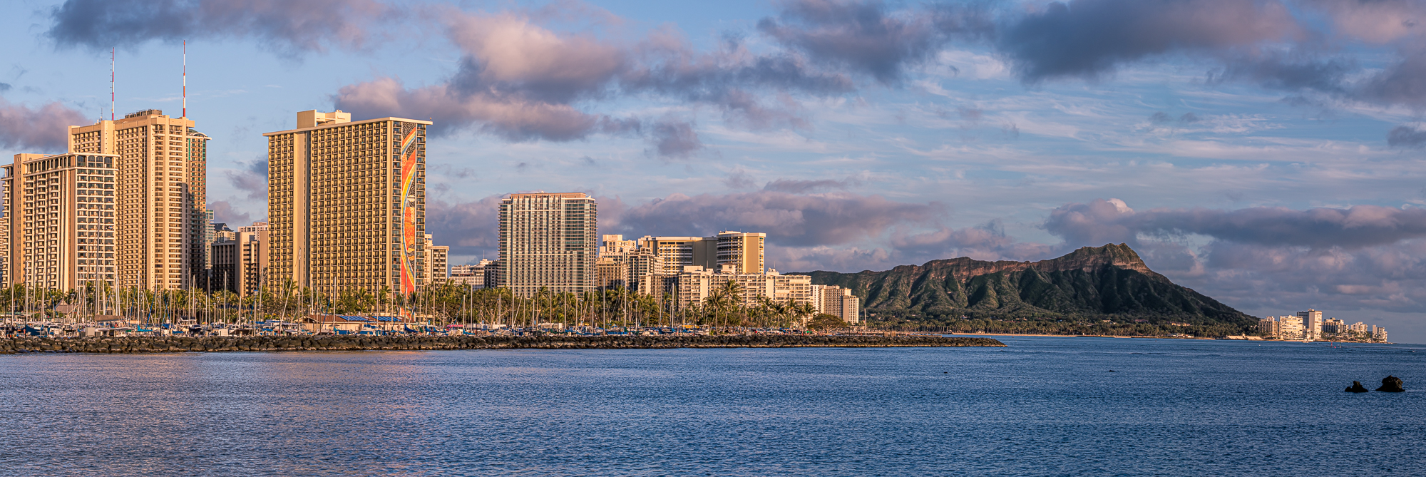 Waikiki skyline and Diamond Head during golden hour. This is an 8-shot panoramic stitch.