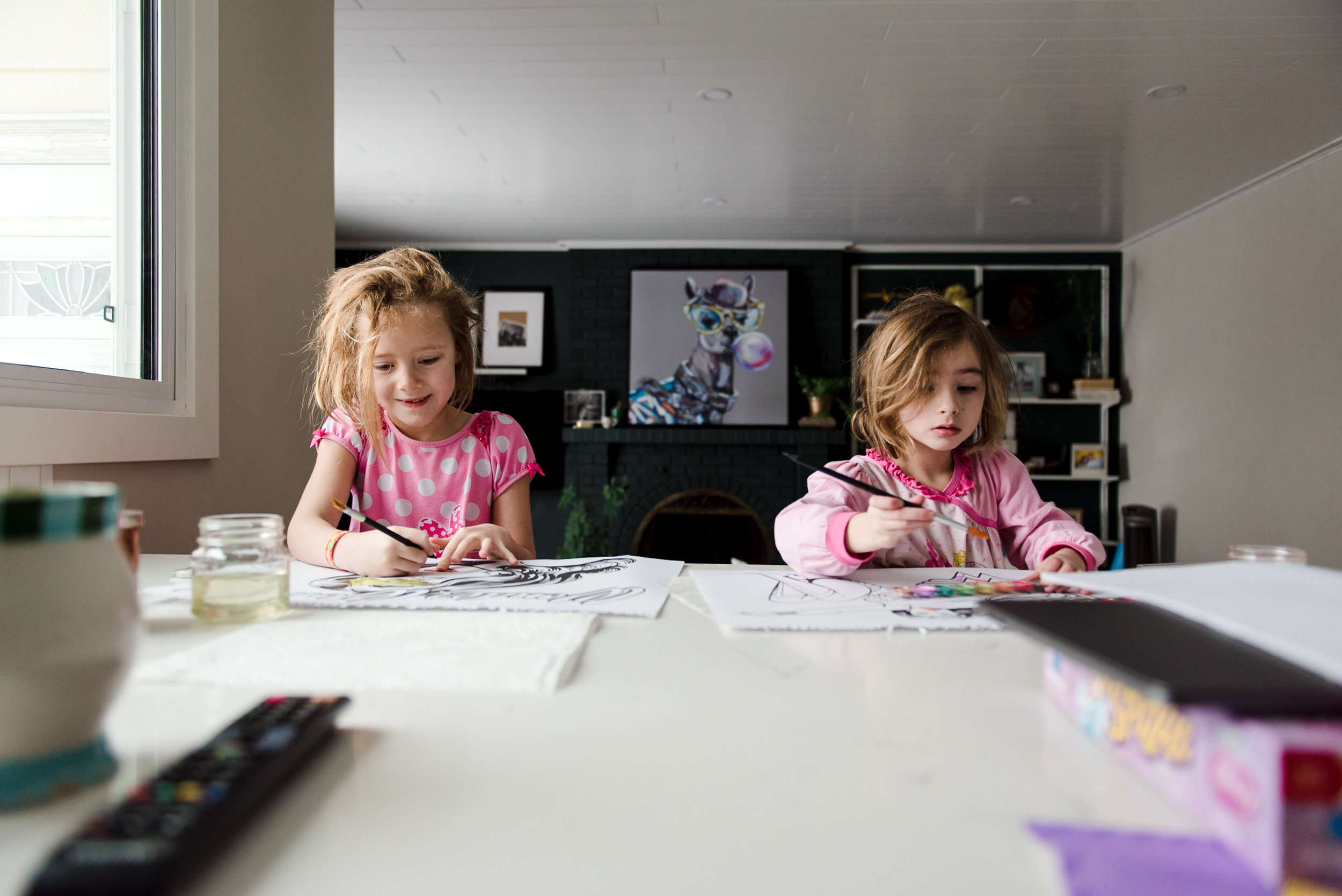 An image of sisters from The Kitchen Counter Series - a photography exercise on Unscripted.
