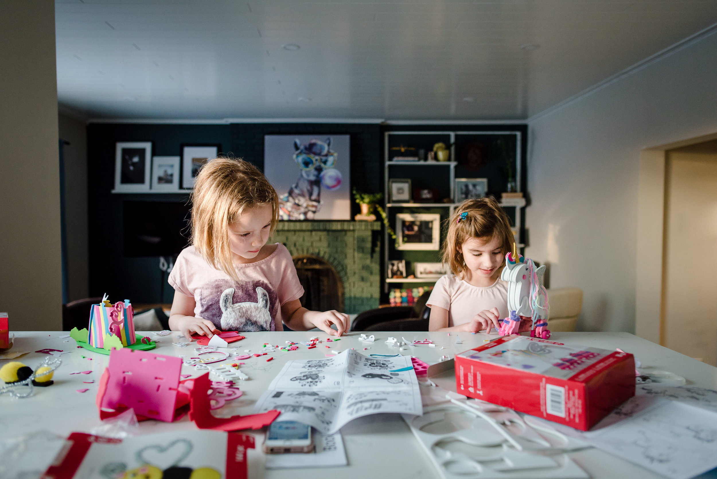 Sisters sit at a counter as part of a photography exercise on Unscripted Mentoring