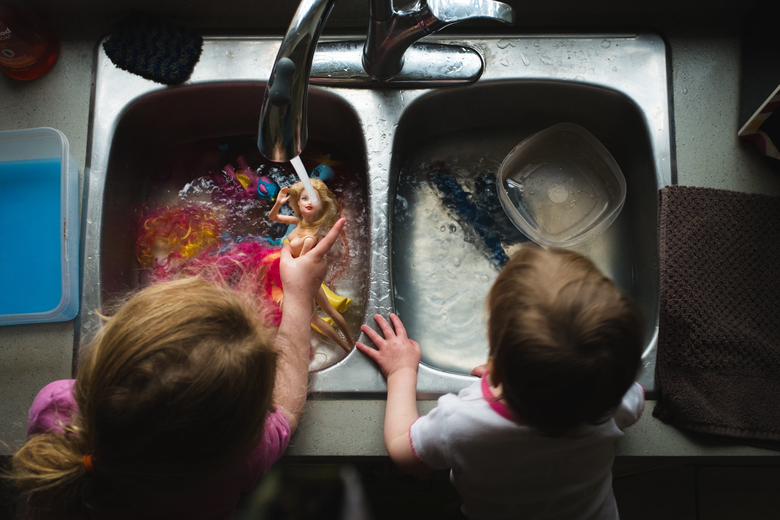 sisters play in the sink.jpg
