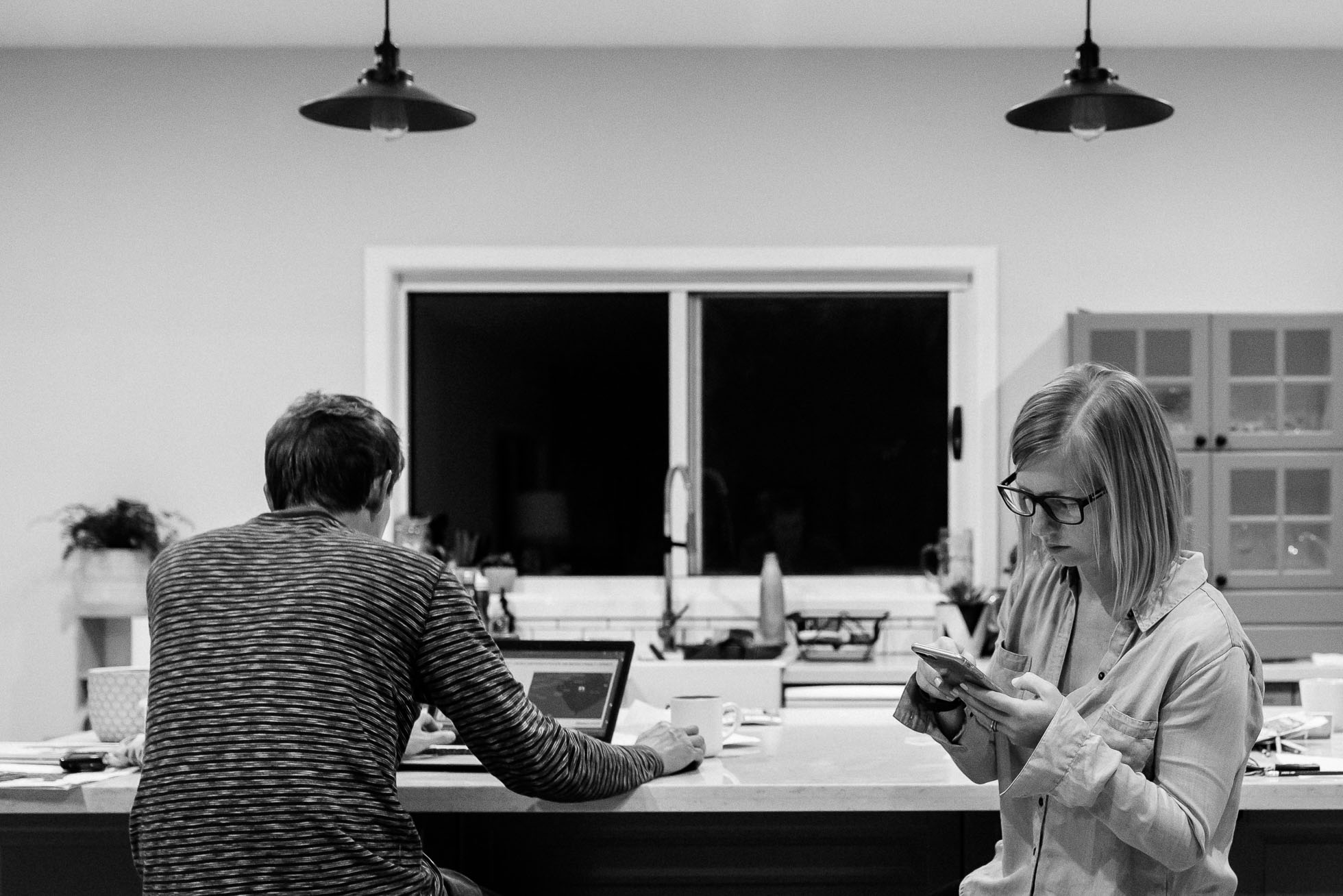self-portrait-couple-working-together-at-counter-on-technology-black-and-white-photography.jpg