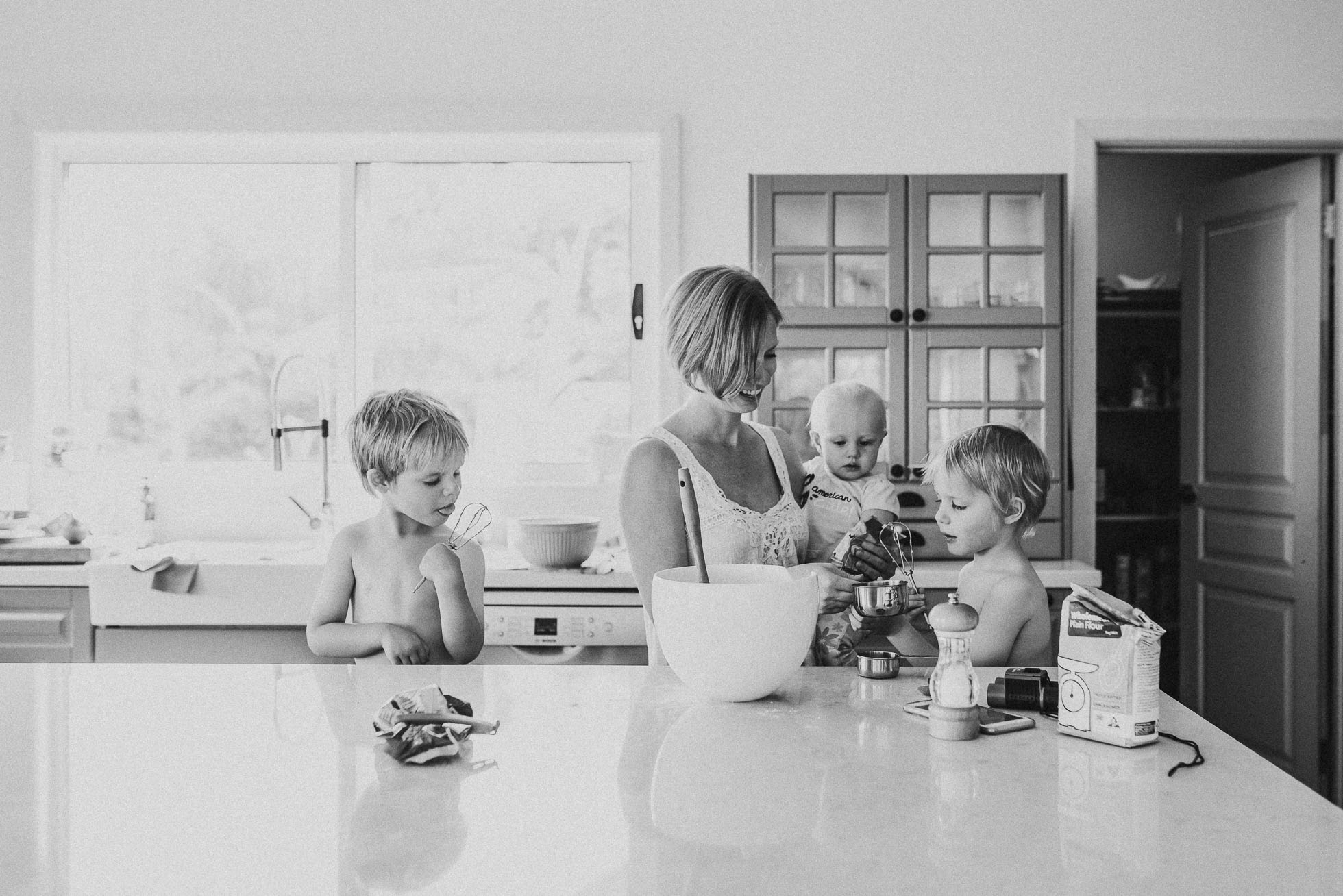 self-portrait-in-kitchen-baking-with-children-black-and-white-photography.jpg