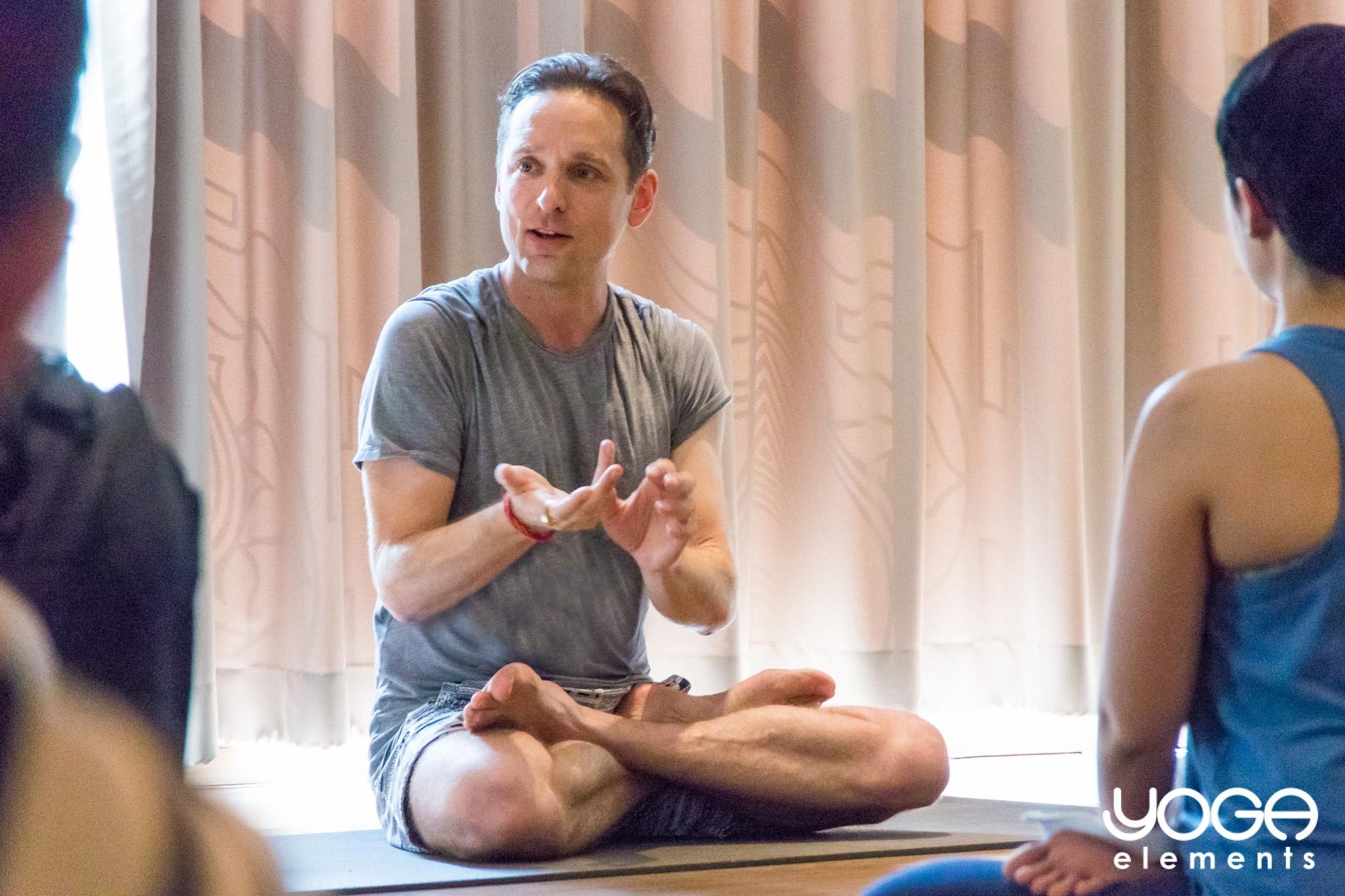 image of Adrian Cox teaching yoga