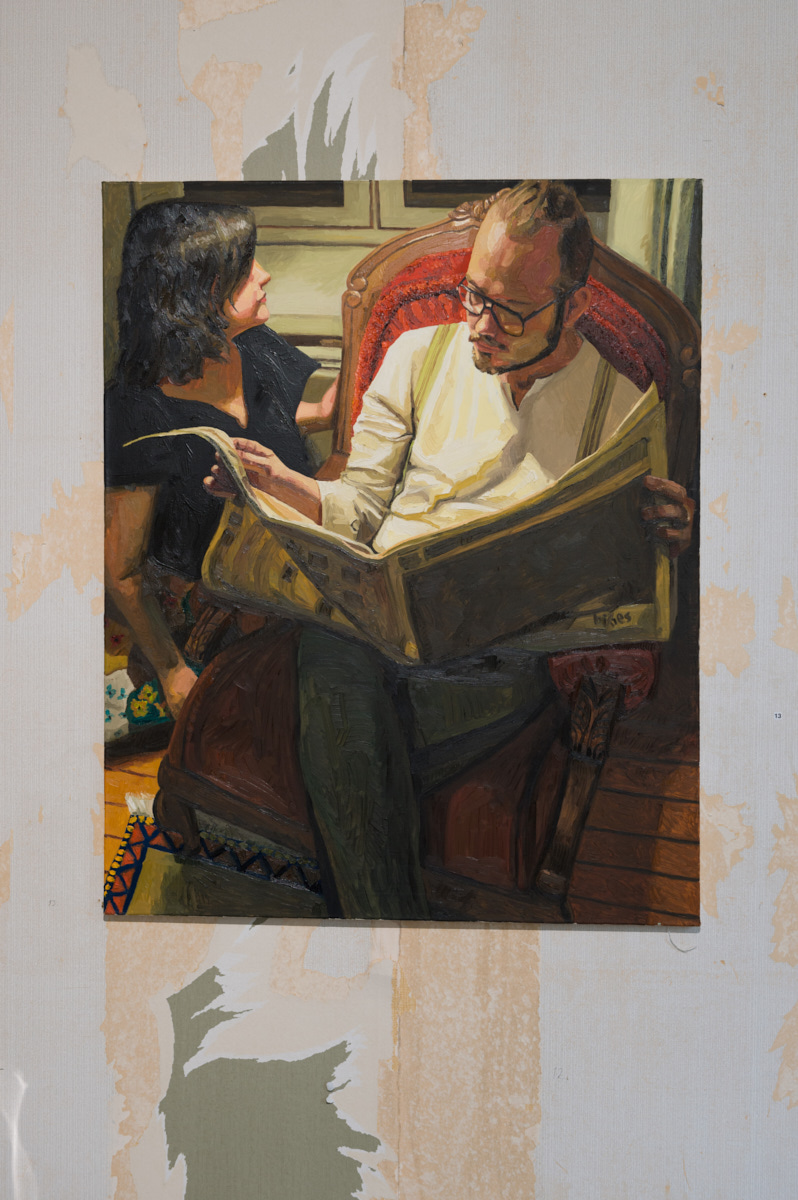 Man reading a newspaper, 2011