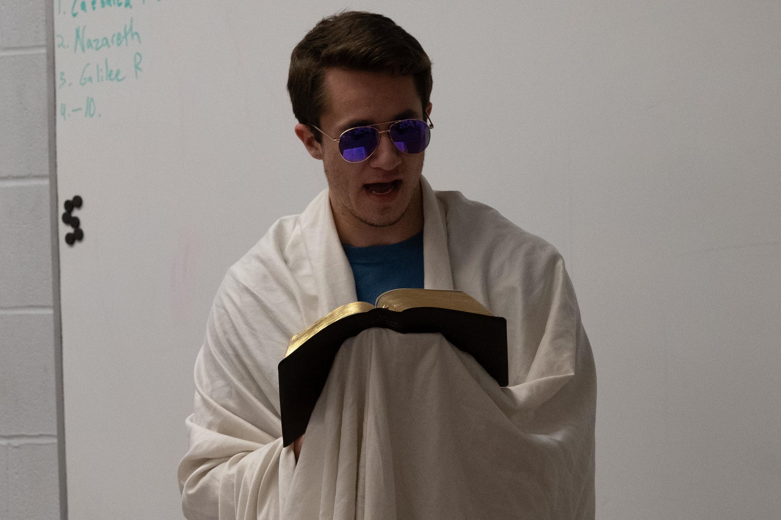 An angel narrator participating in the reenactment of Matthew 4.