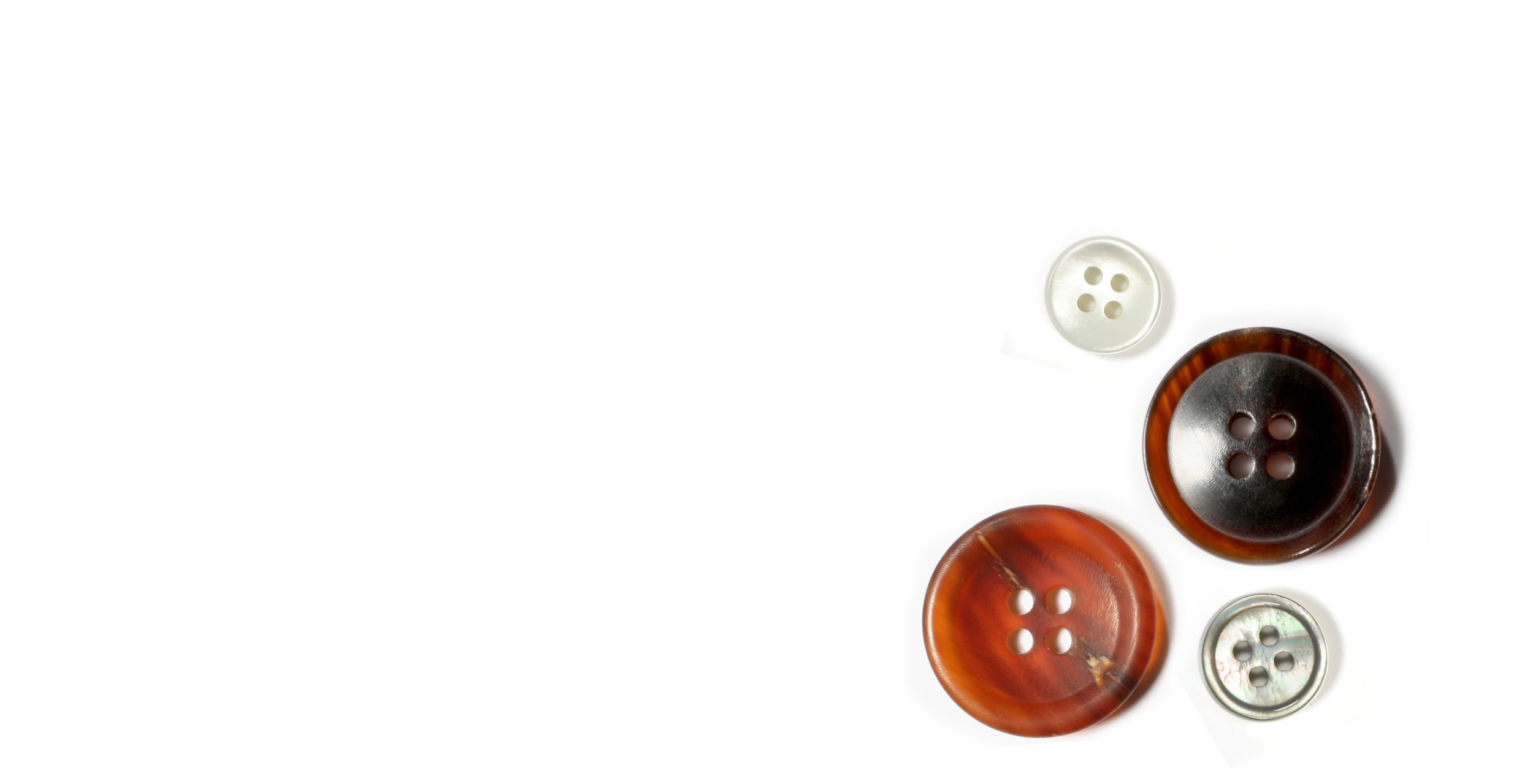 Quality Buttons - We offer a curated range of natural horn, mother of pearl and bone button options for a distinctive finish.