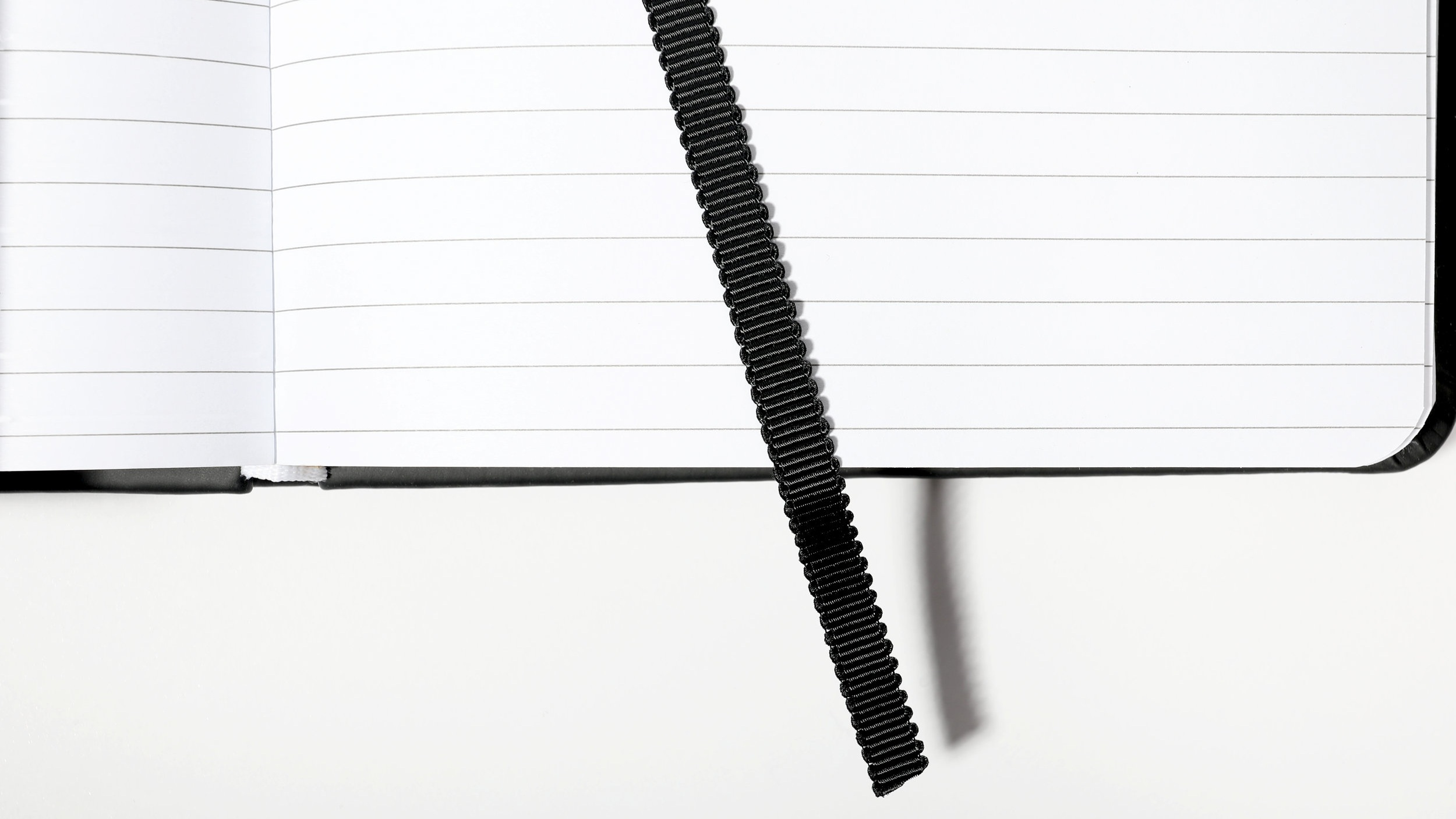 Grosgrain Bookmark - All our notebooks feature a signature black grosgrain bookmark. Style is all in the details.