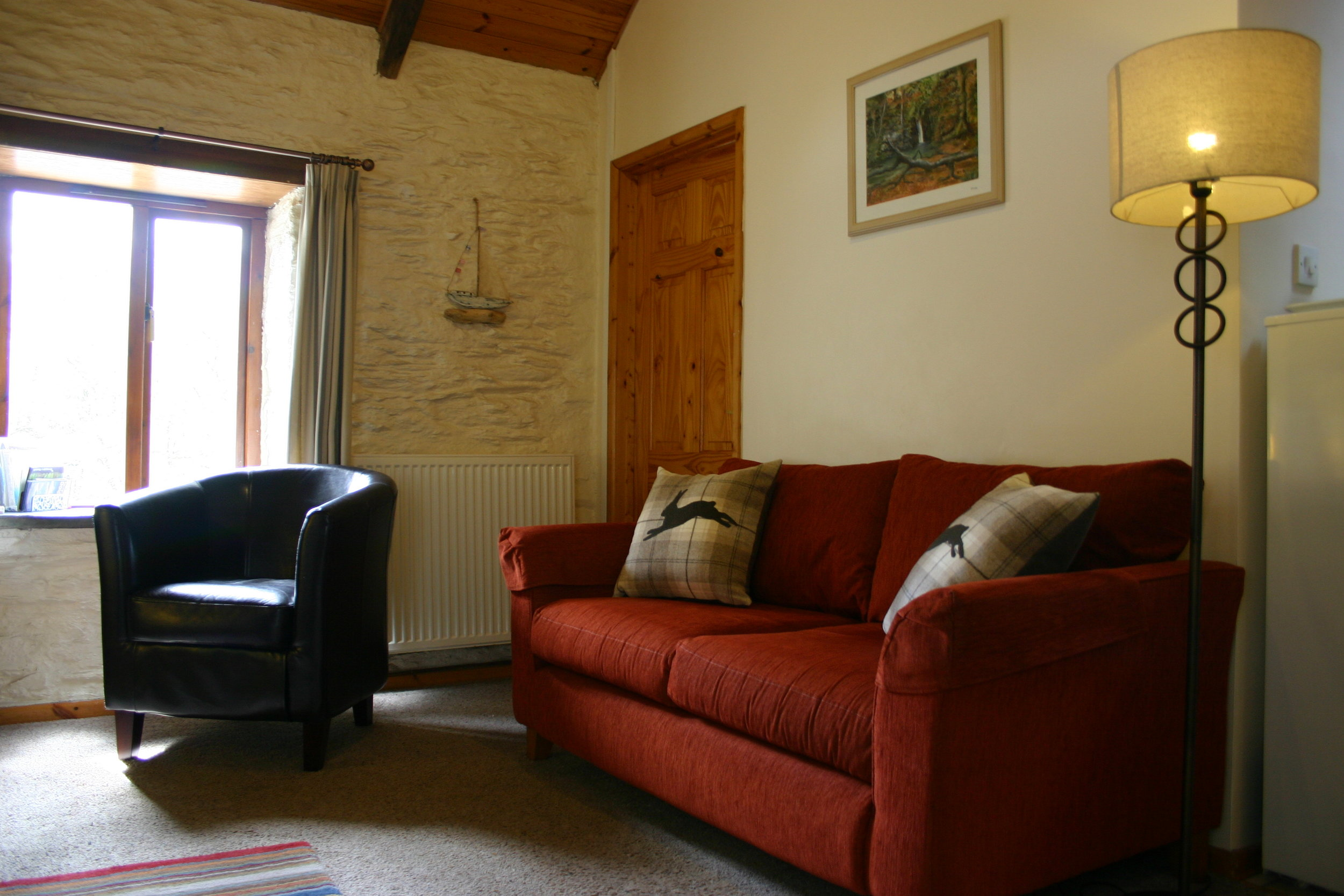 Gorse Cottage - Gorse Cottage is a two bedroom holiday cottage sleeps three graded 5 stars by Visit Wales. The self catering cottage sleeps up to three and have a sitting/dining room with fully equipped galley type kitchen off. This cottage is all on one level. There are two bedrooms one with double bed, the other with a single bed. The bathroom has a bath and shower over.