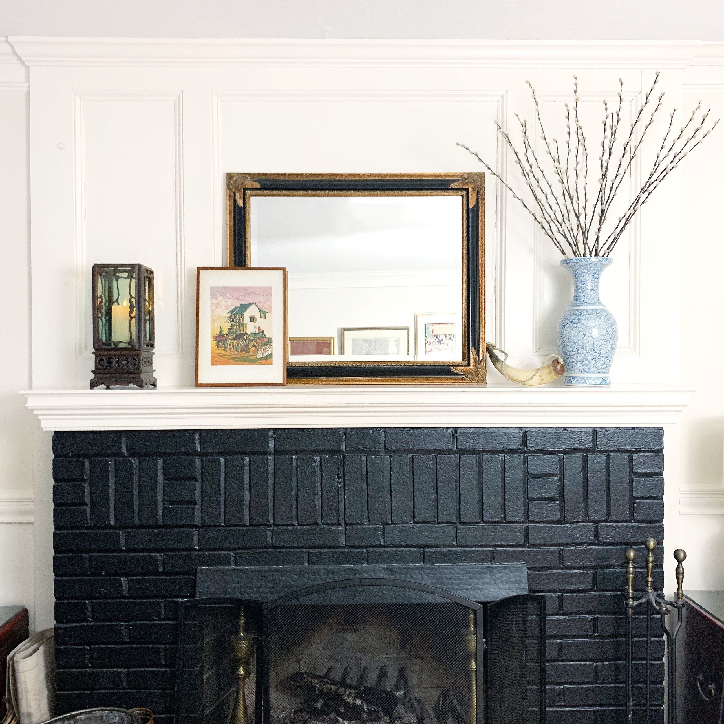 A slightly different mantel scape: mirror positioned horizontally, rosewood lantern, and Singaporean batik artwork.