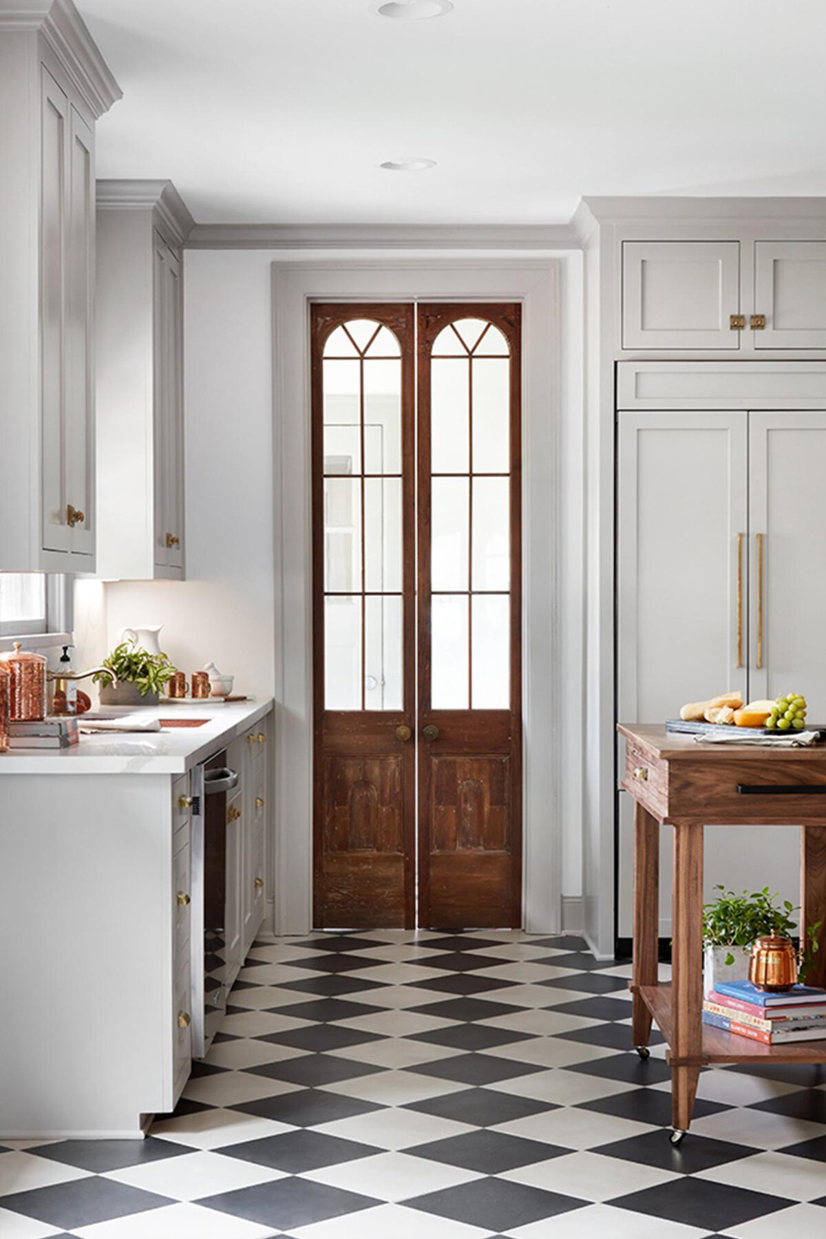 craftsman-farmhouse-style-kitchen-with-black-and-white-checkered-floors-fixer-upper.jpg