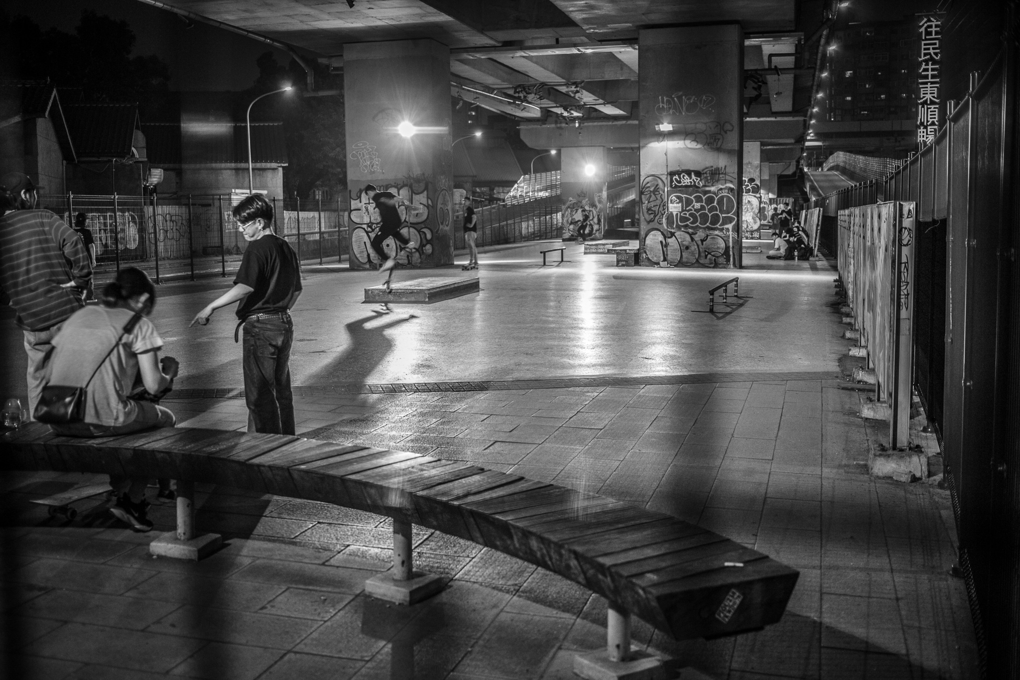 Skateboarders at midnight.