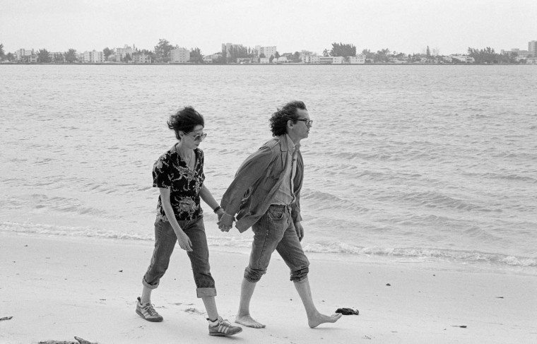 "Christo and Jean Claude walking on the beaches of Miami in 1983 during their creation of ""Surrounded Islands"" in the Biscayne Bay"