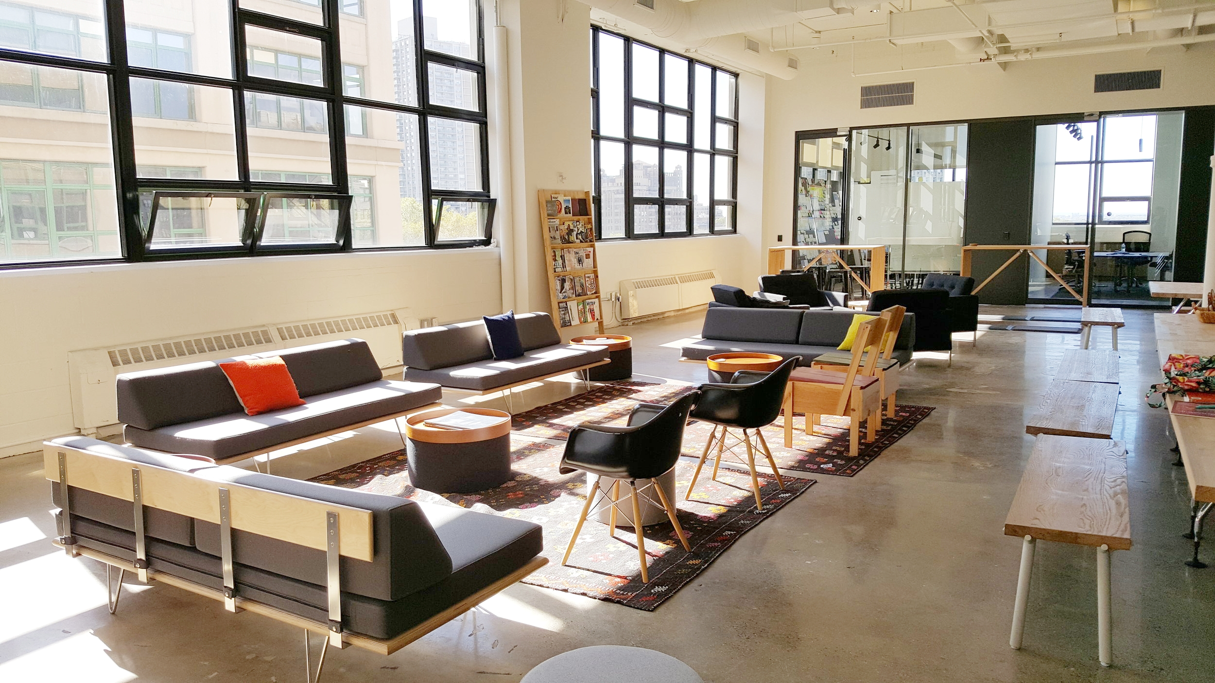 Frog's large open team room is a favorite space to relax or informally collaborate. A wall of windows and a 15.5 foot ceiling fill the space with light and views.