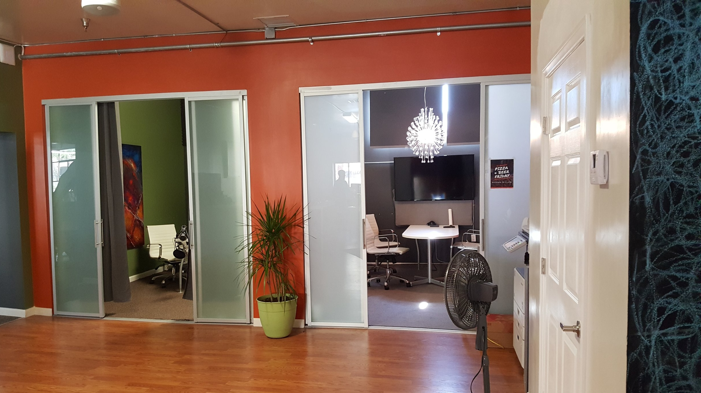 Small meeting rooms are equipped to record podcasts or ideas on whiteboards.