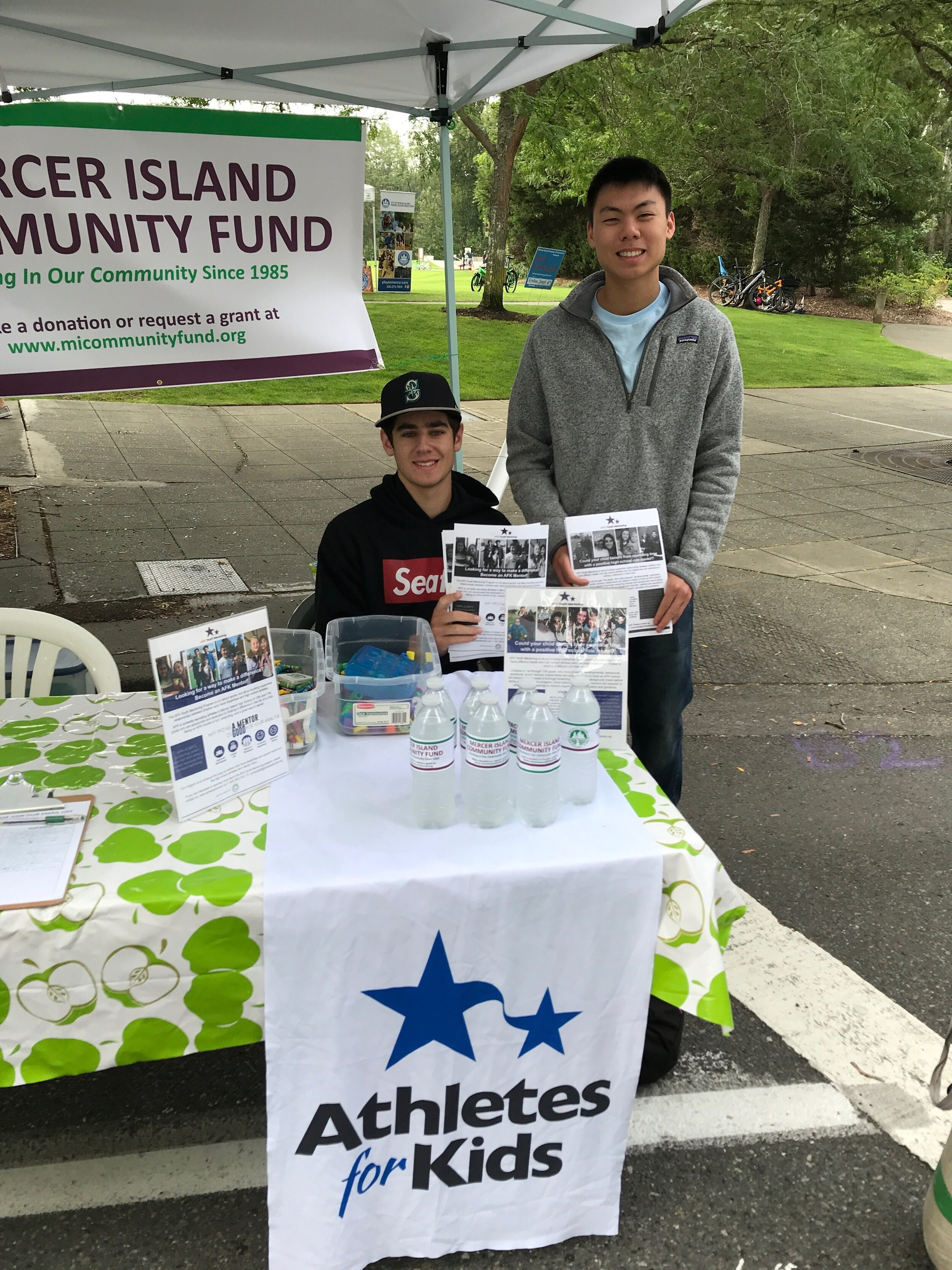 Athletes for Kids and MI Community Fund shared a booth at Farmer'