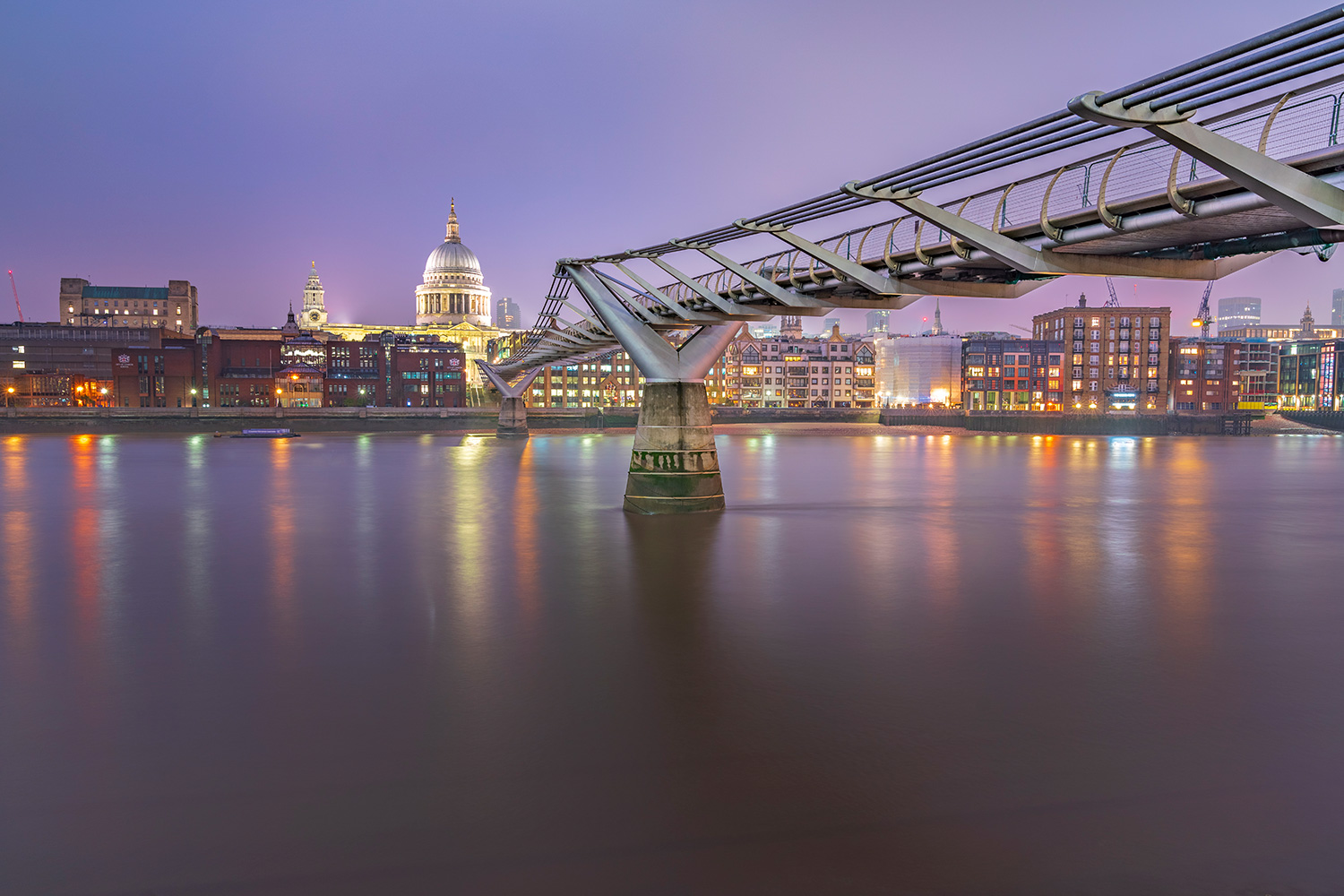 St Paul's Cathedral with Millenium Bridge across the Thames at night
