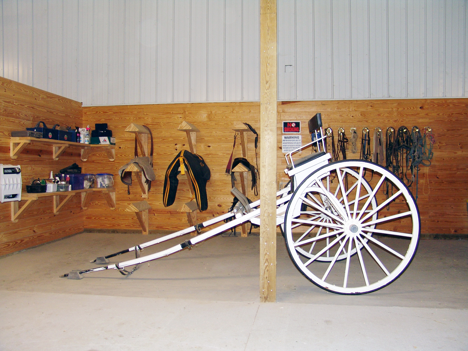 Tack area with build-in saddle racks