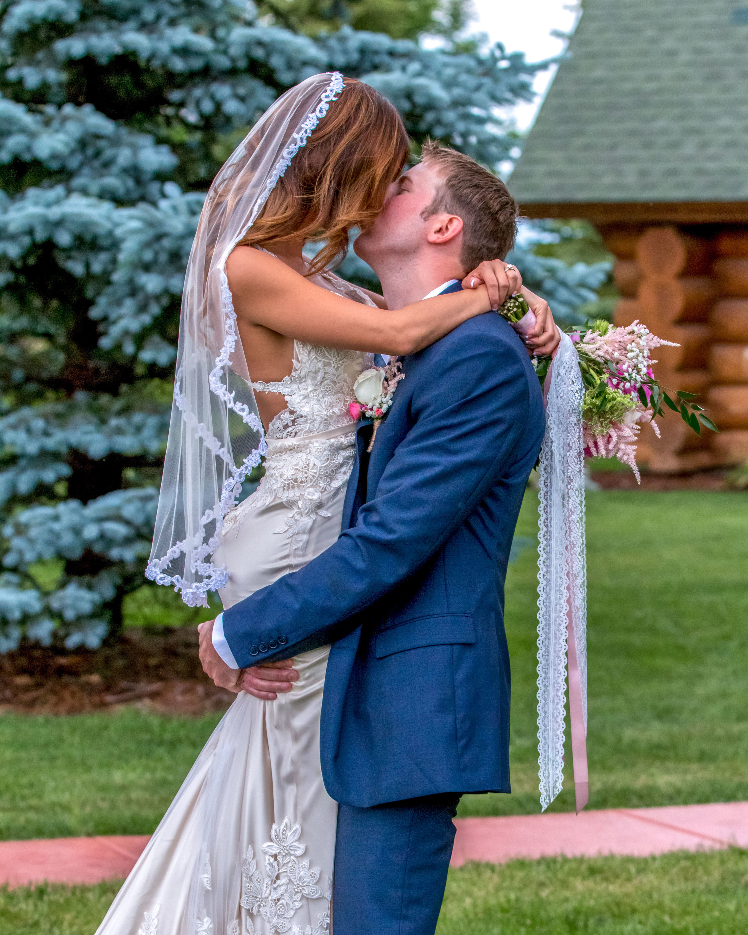 Minnesota Wedding at Glenhaven, outdoor ceremony, Fab Weddings, groom picking up bride
