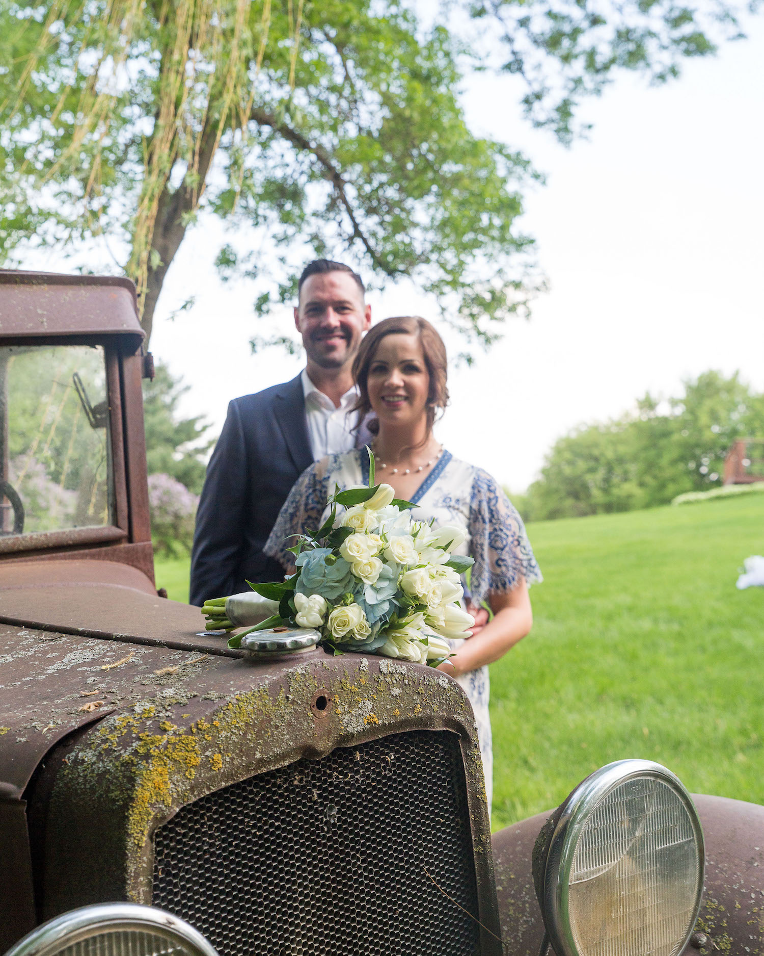 Cindyrella's Garden, pregnant bride in blue and white lace wedding dress, rusty truck photo
