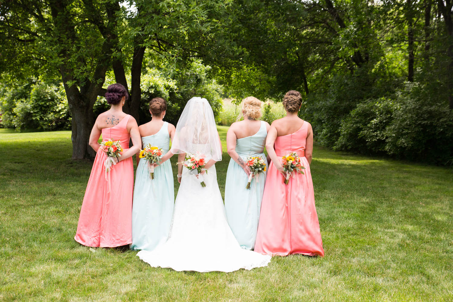 Cindyrellas Garden, outdoor lake ceremony in Minnesota, coral and mint bridesmaids dresses
