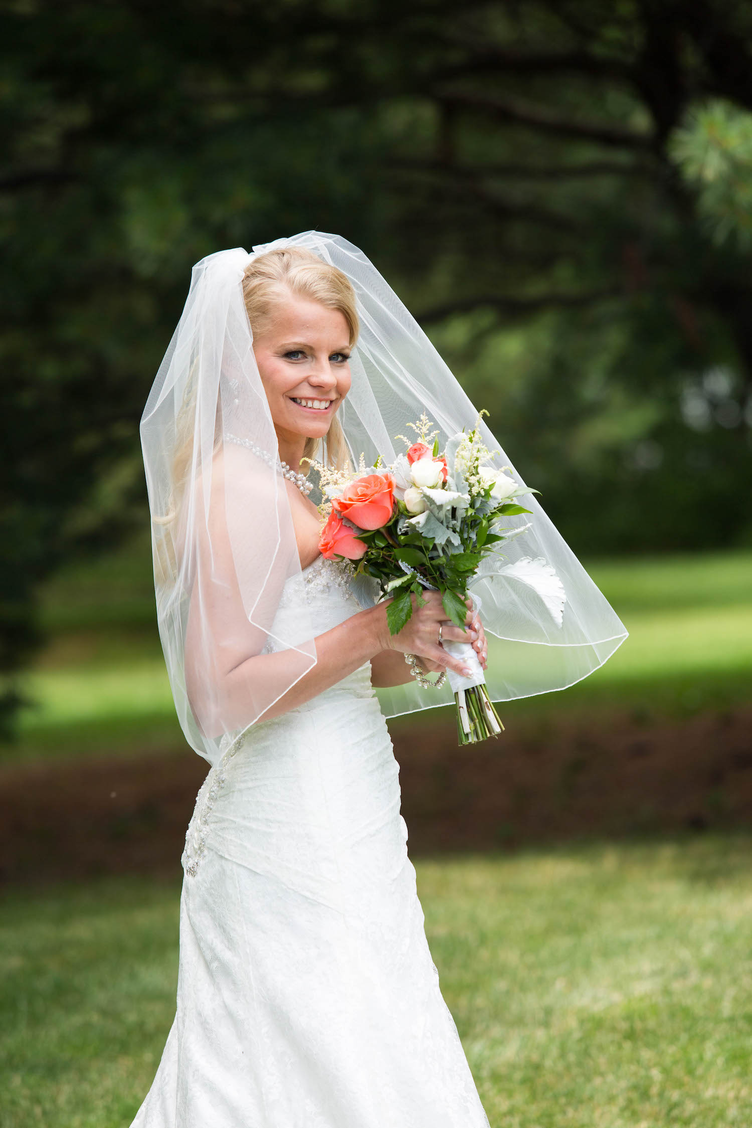 Cindyrellas Garden, outdoor lake ceremony in Minnesota, blonde bride
