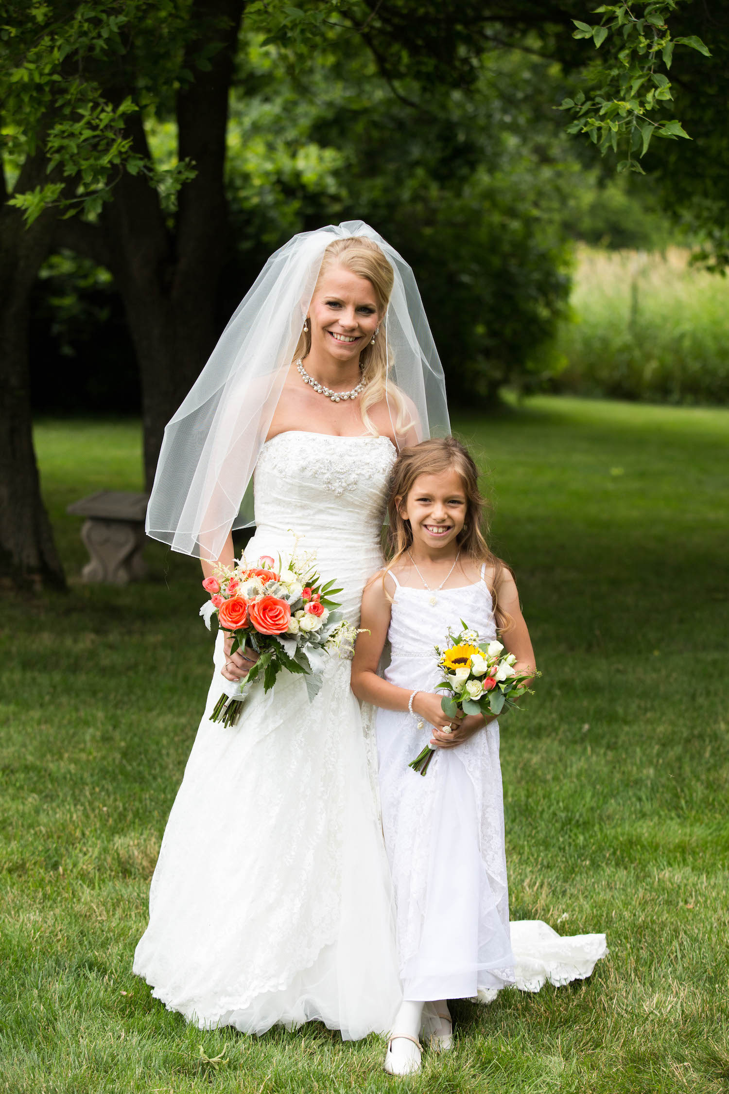 Cindyrellas Garden, outdoor lake ceremony in Minnesota, flower girl in white