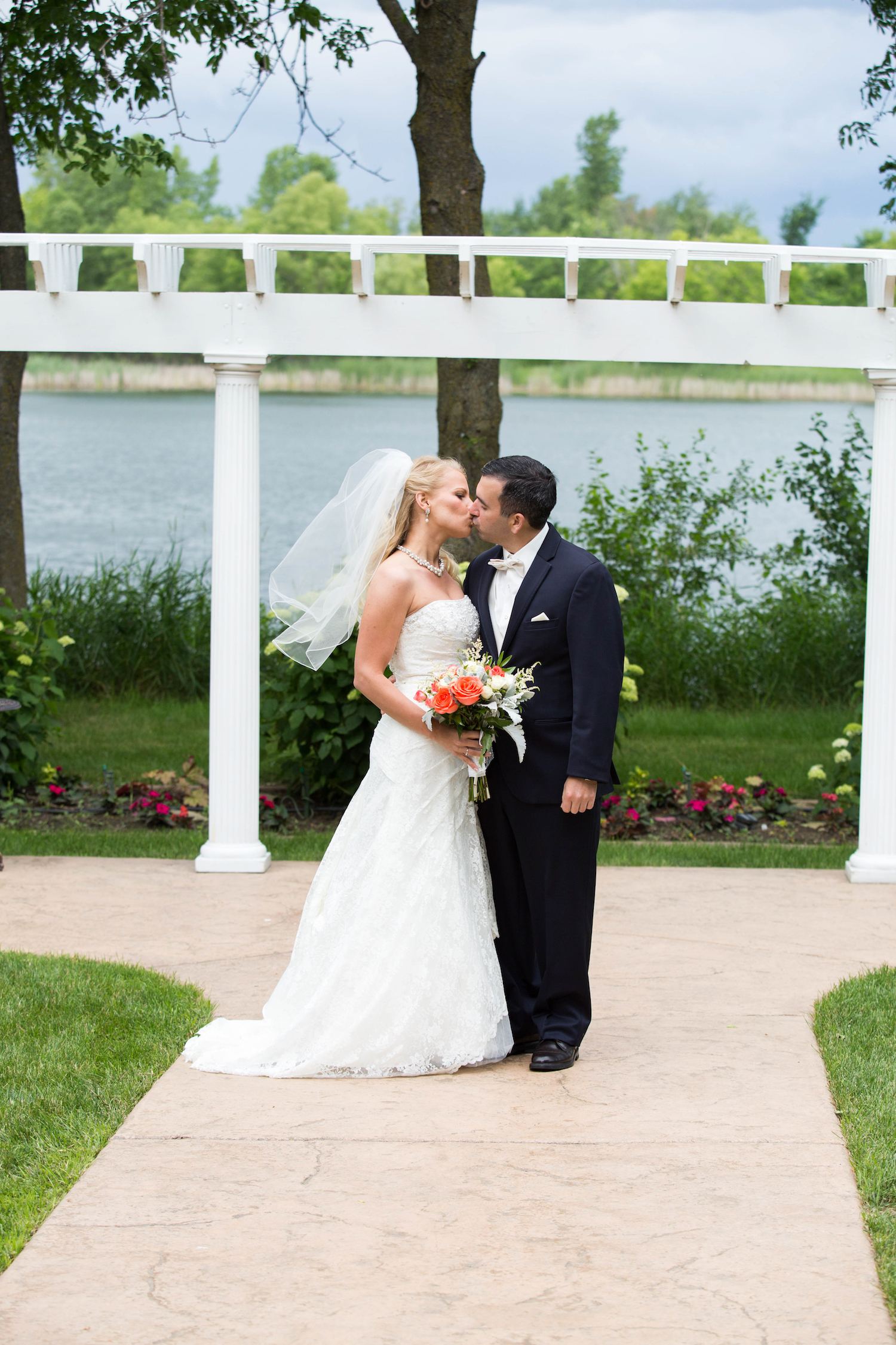 Cindyrellas Garden, outdoor lake ceremony in Minnesota, built in arbor