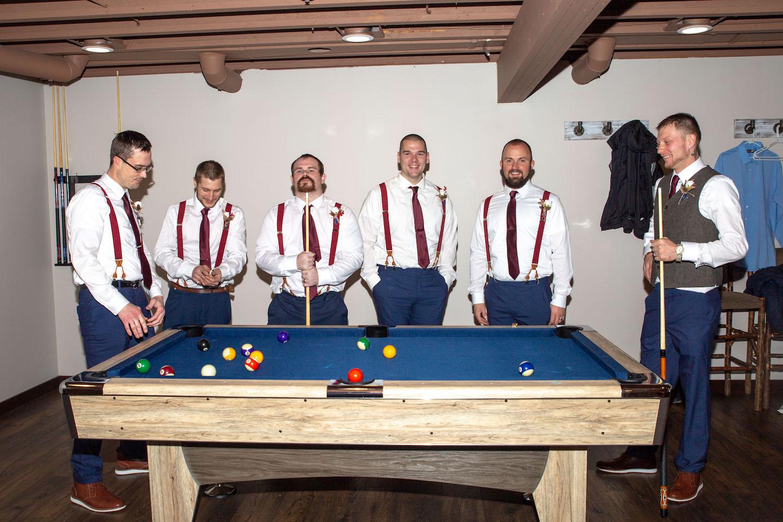 Glenhaven winter Minnesota wedding rustic barn, pool table in the groom's room
