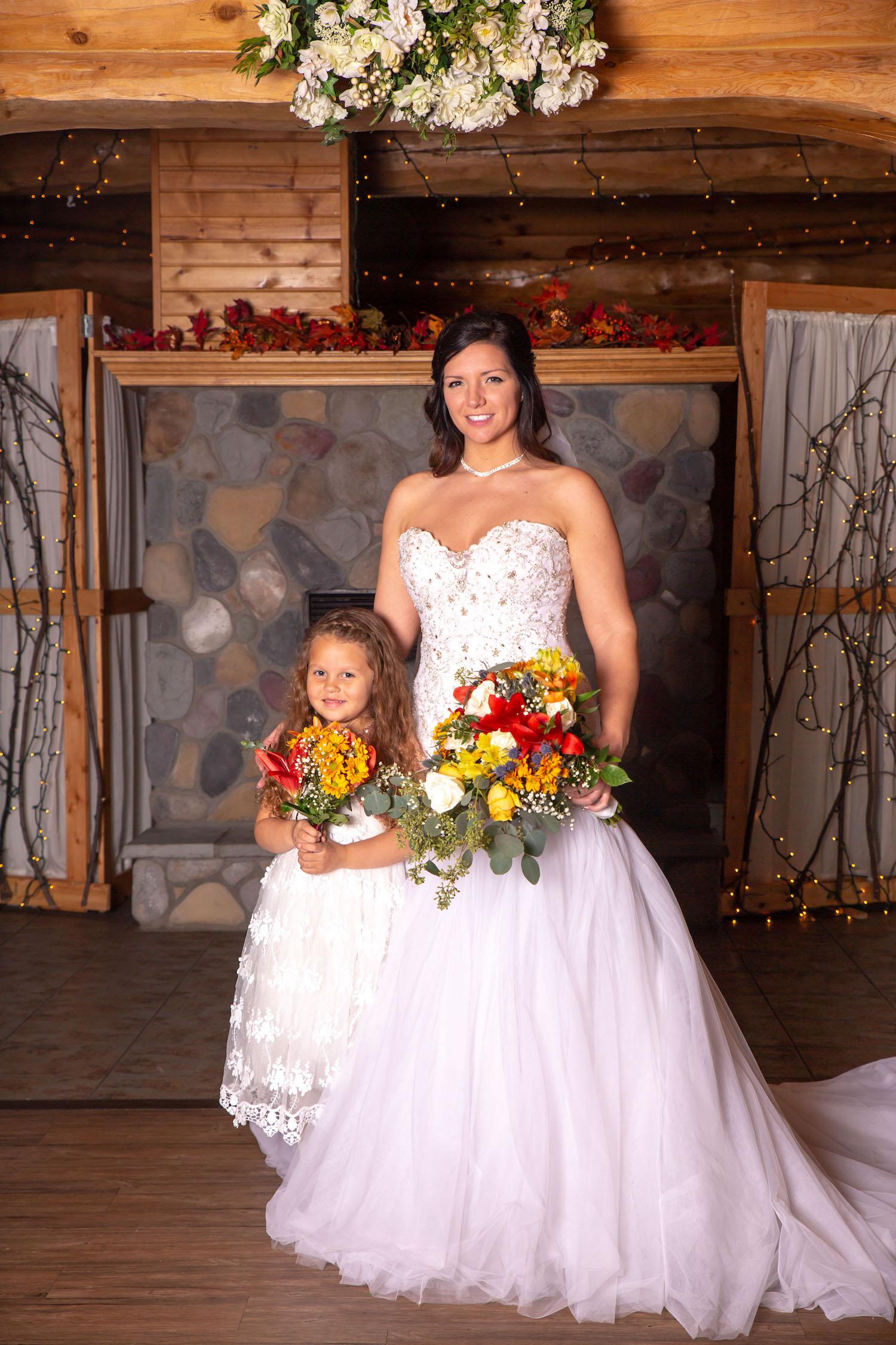 Glenhaven winter Minnesota wedding rustic barn, orange and yellow bouquet, flower girl photo