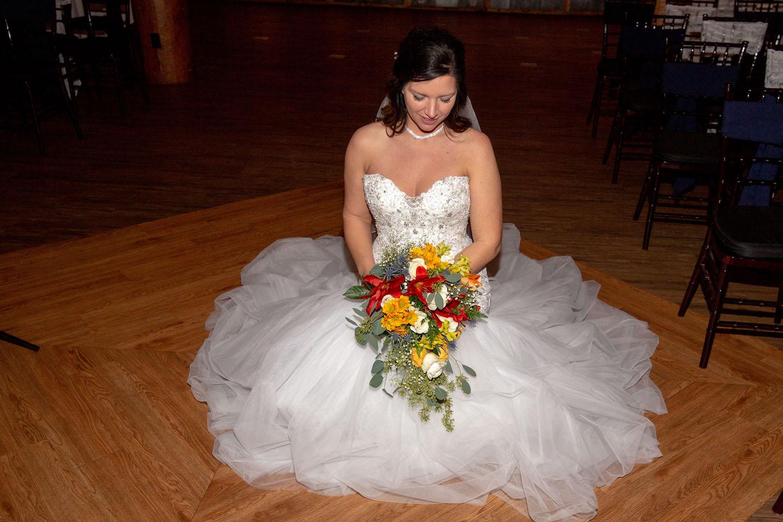 Glenhaven winter Minnesota wedding rustic barn, orange and yellow bouquet, sitting photo