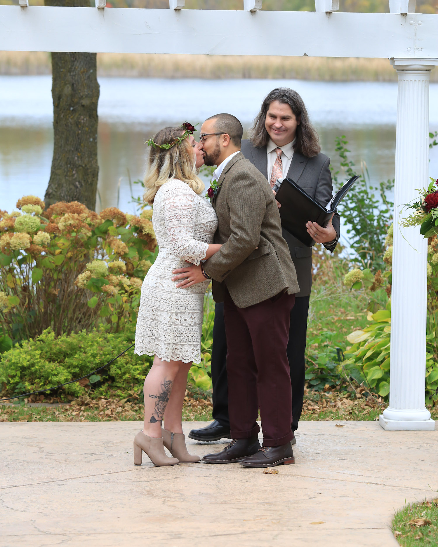 Cindyrella's Garden, outdoor ceremony on the lake in Minnesota, first kiss