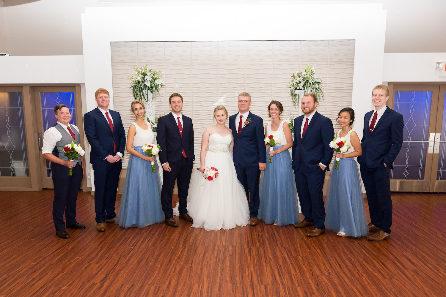 Rosehenge wedding, Lakeville wedding venue, affordable wedding venue in south Minnesota, bridesmaids in separates with dusty blue tulle skirts