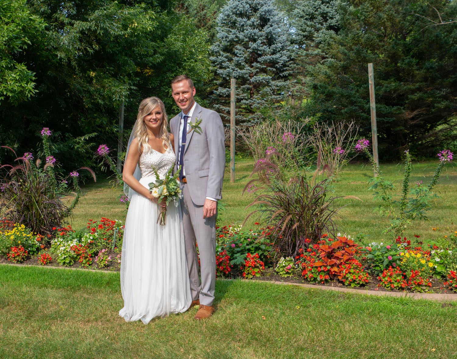 Cindyrellas Garden outdoor wedding ceremony by a private lake with wooded backdrops,