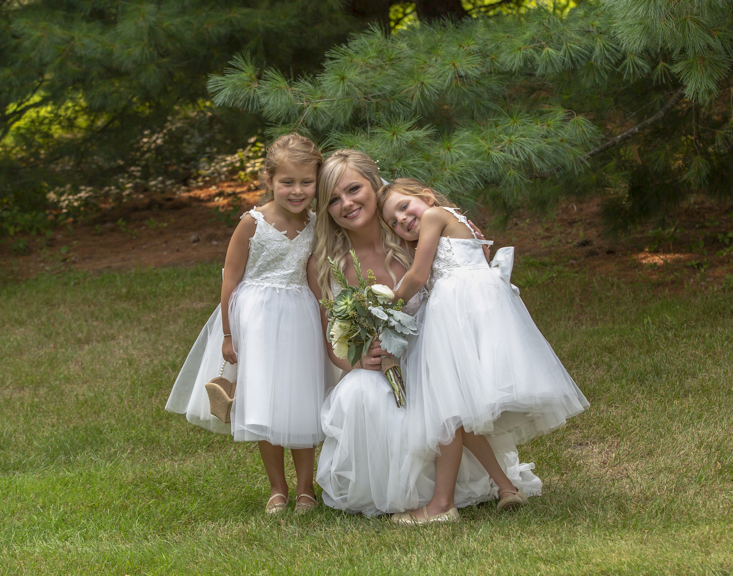 Cindyrellas Garden outdoor wedding ceremony by a private lake with wooded backdrops, flower girls with the bride
