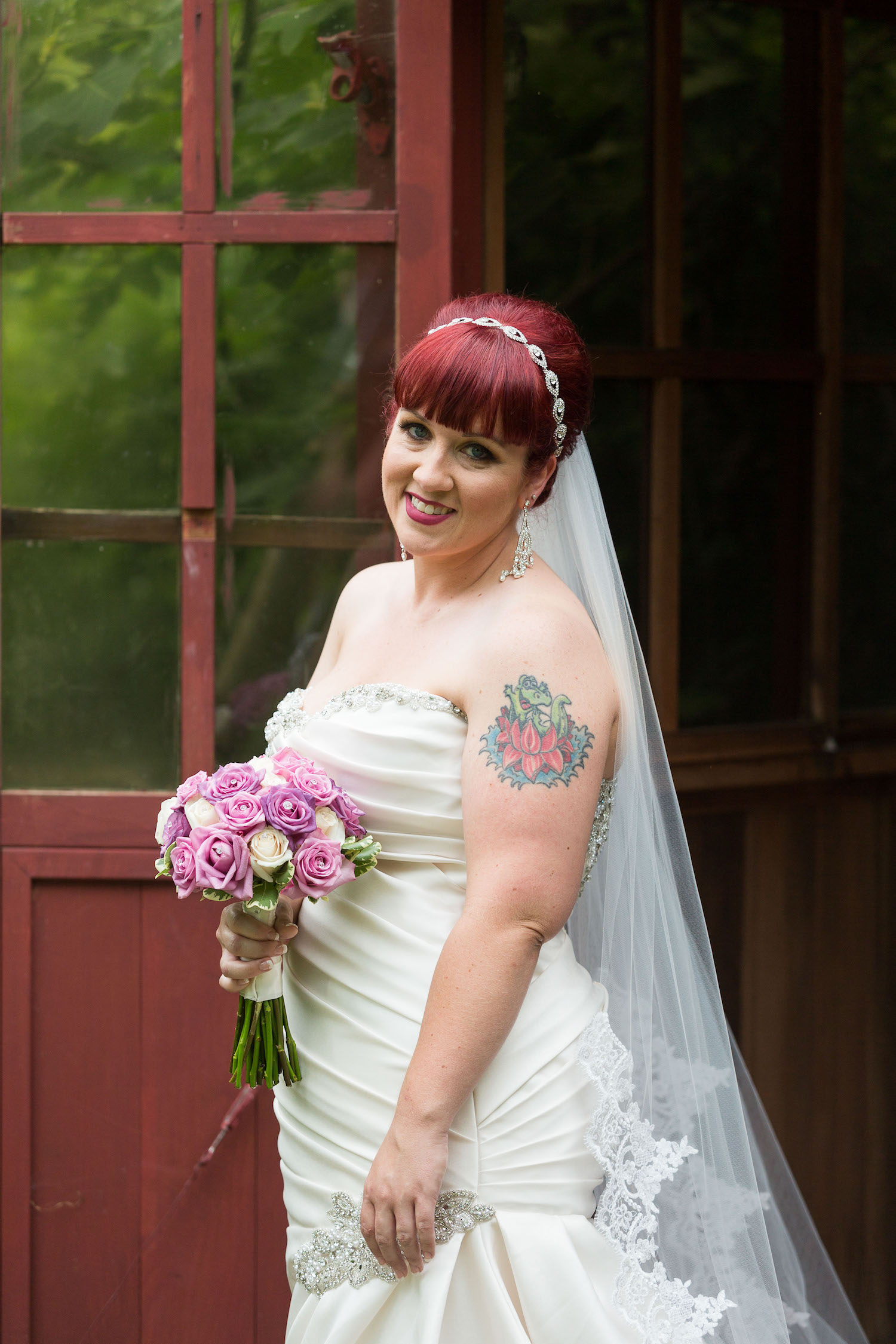 Cindyrella's Garden outdoor ceremony by the lake with a redhead bride, small rose bouquet pink and white, shoulder tattoo