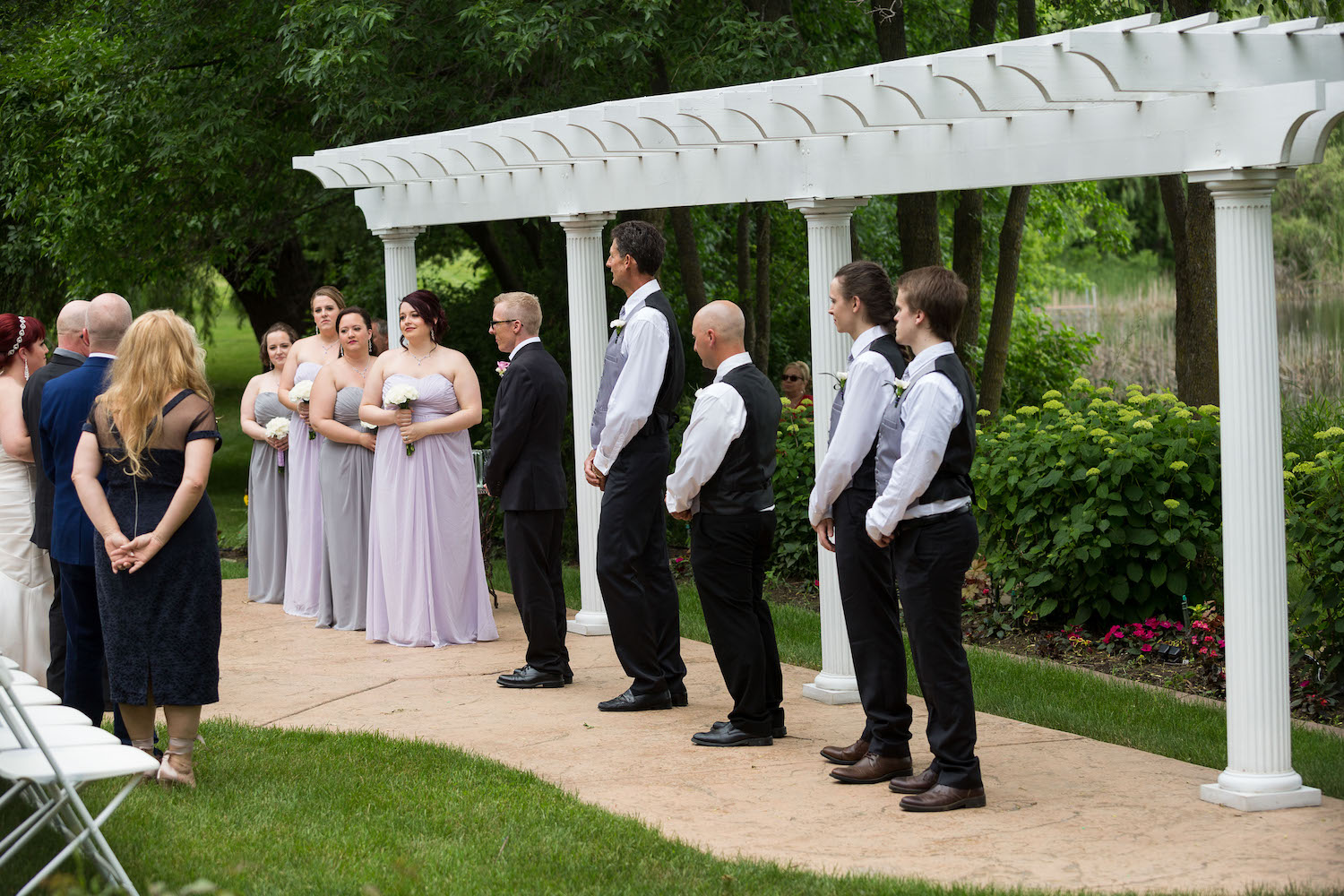 Cindyrella's Garden outdoor ceremony by the lake with a redhead bride, built in arbor