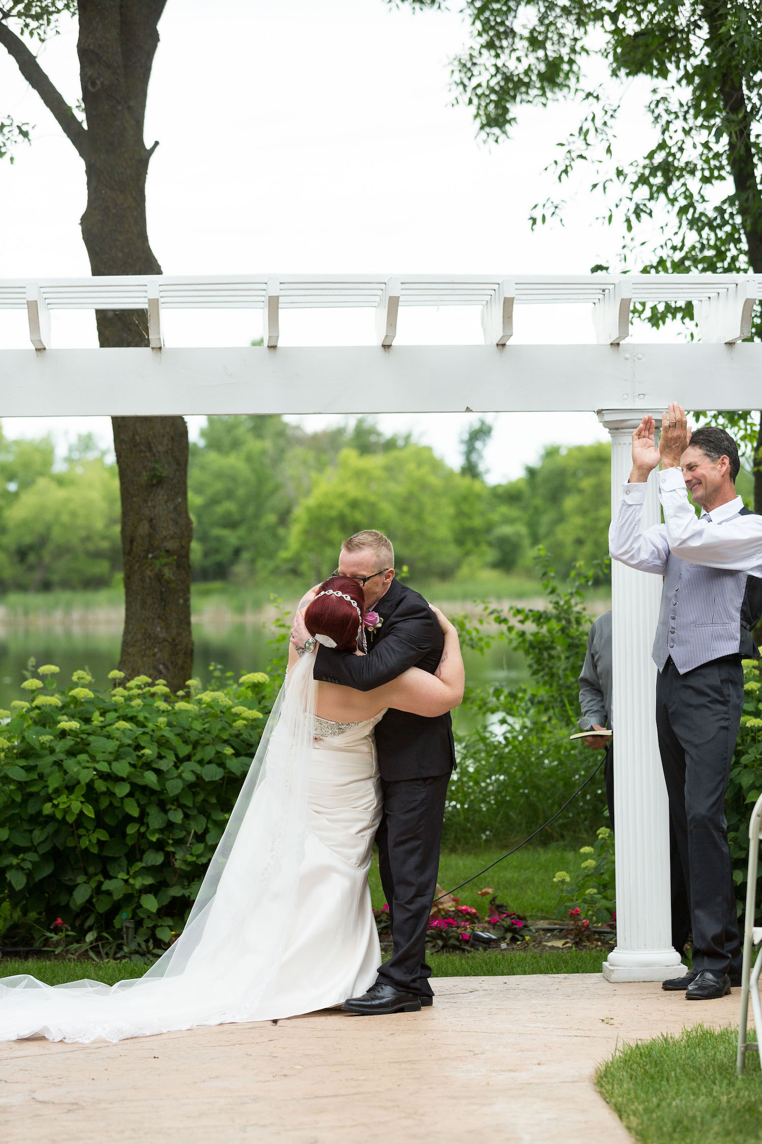 Cindyrella's Garden outdoor ceremony by the lake with a redhead bride, dip kiss