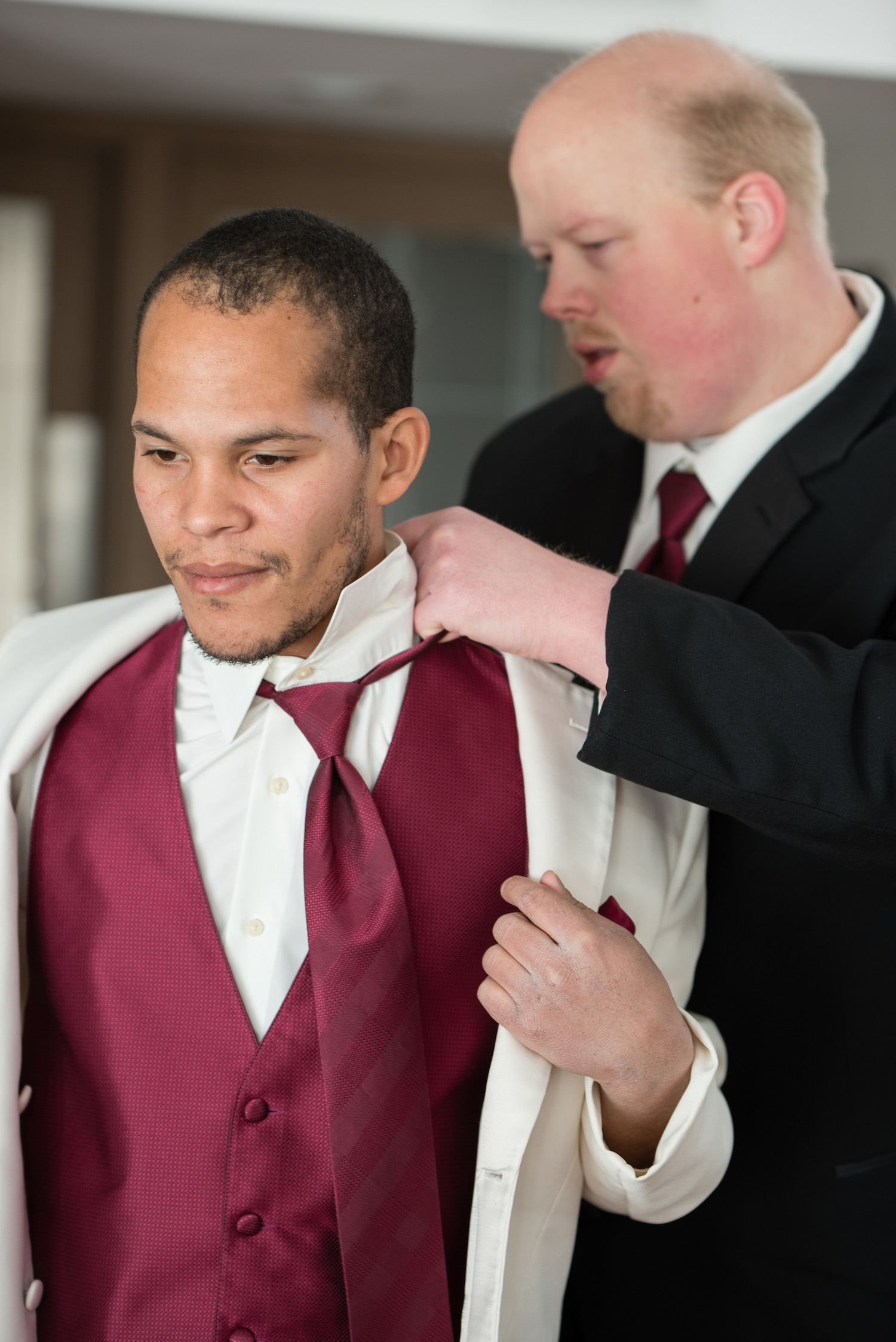 Danielle Albrecht wedding photo | groom getting ready | white suit