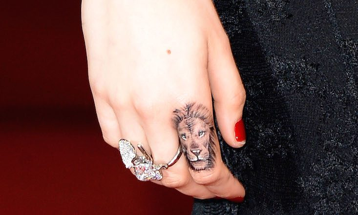 Cara's lion finger tattoo is the first tattoo I found myself liking