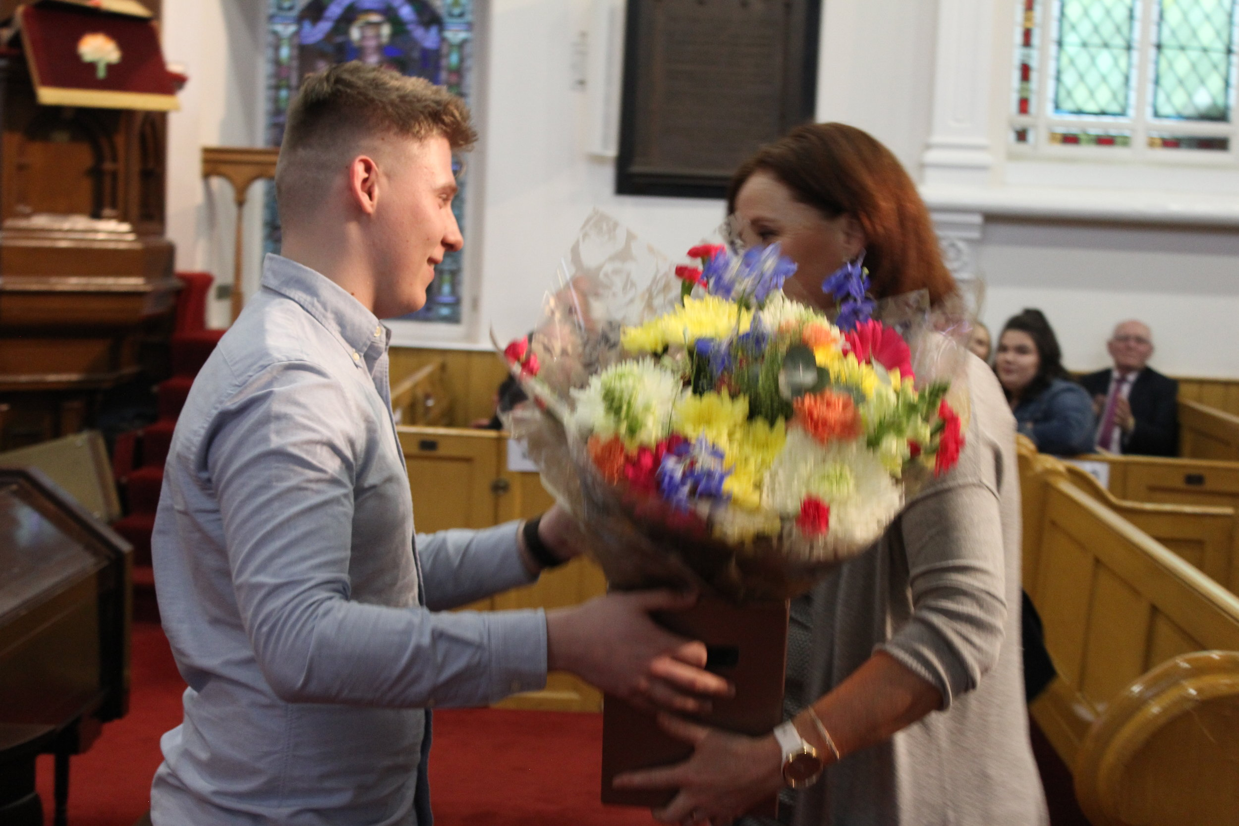 Oliver Owens presents Mrs McCracken with flowers.