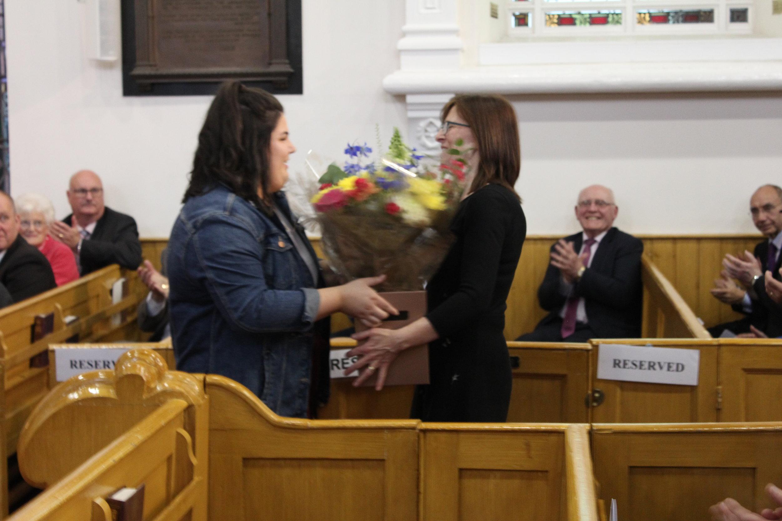 Natasha Hamilton presents Mrs Crowe with flowers.