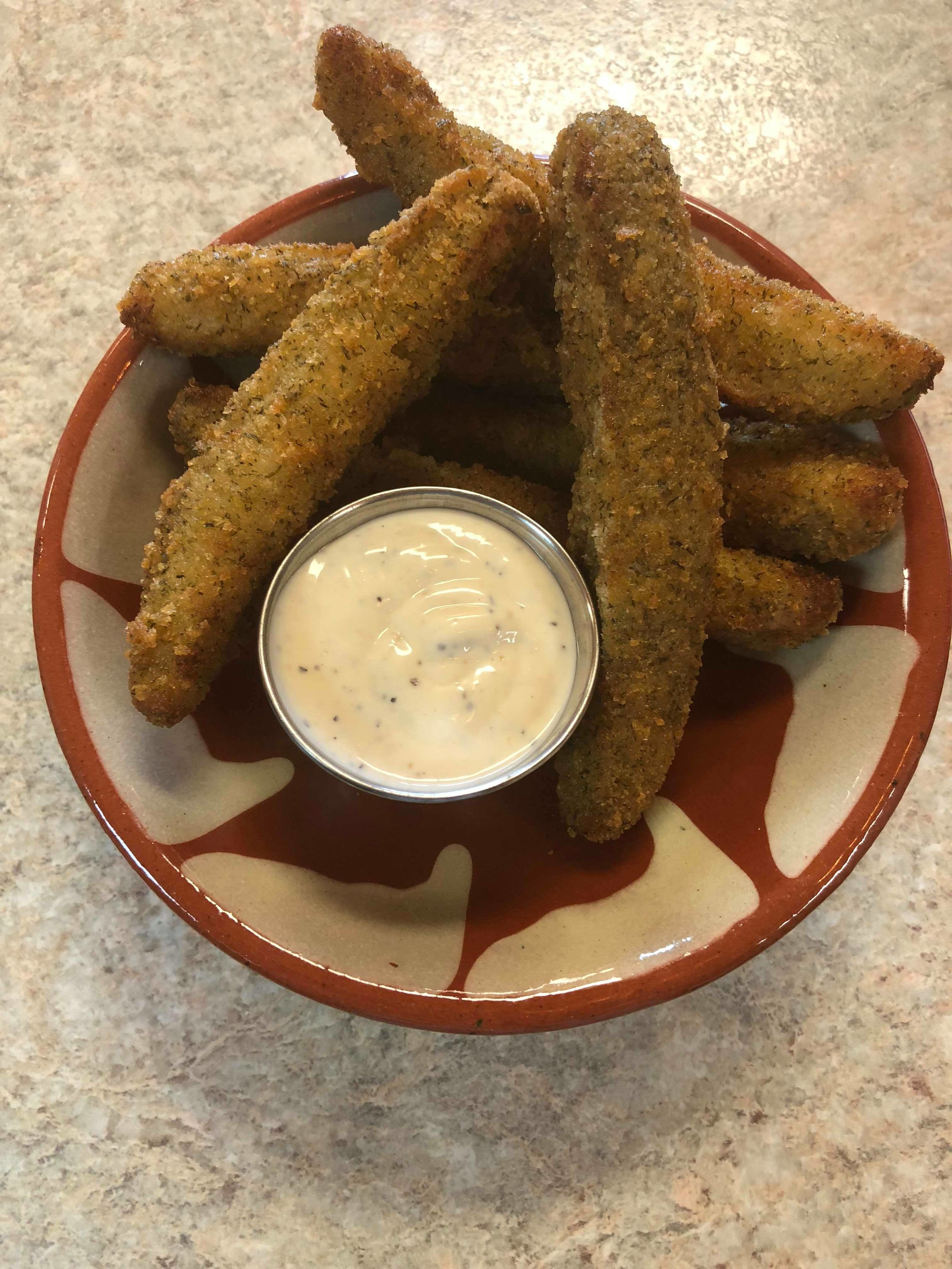 SIDES - Fresh Cut Fries - $4.45Garlic Potatoes - $4.45Poutine - $5.49Onion Rings - $4.99Deep Fried Pickles - $5.99Stuffed Grape Leaves - $3.99